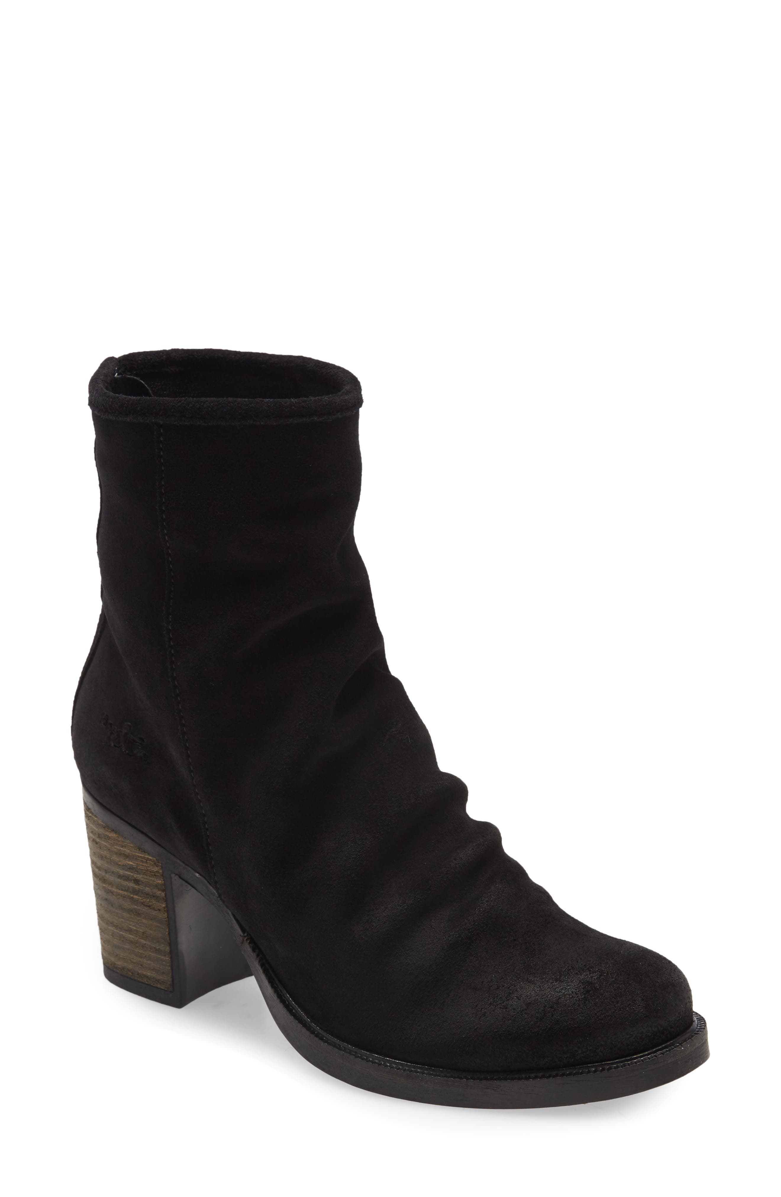 Soft ruching at the vamp creates a slouchy silhouette on a waterproof bootie lifted by a chunky stacked heel and fitted with a cushy, arch-supporting footbed. Style Name: Bos. & Co. Bevy Block Heel Bootie (Women). Style Number: 6086157. Available in stores.