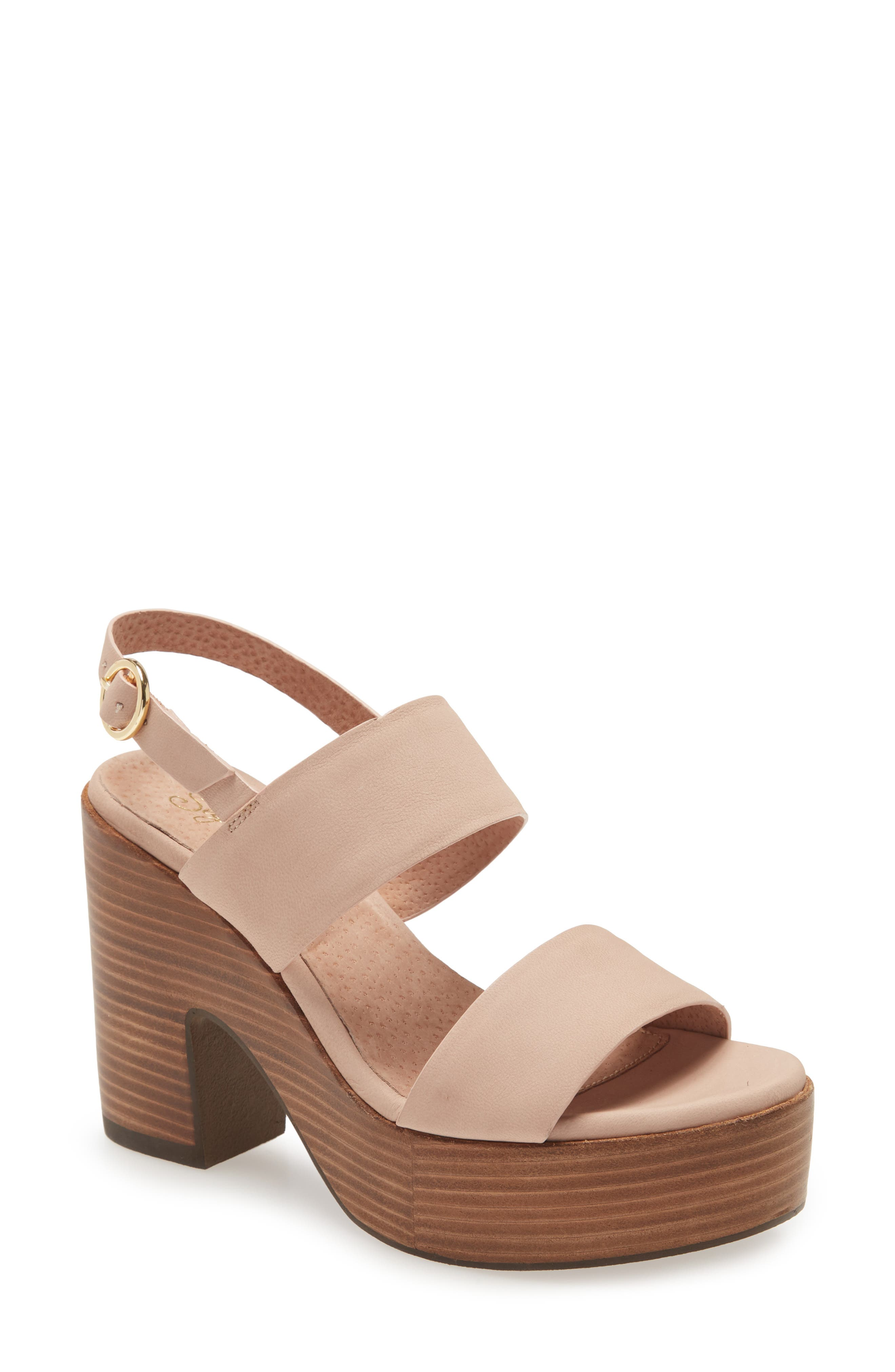 A woodgrain platform and chunky heel bring \\\'70s-inspired height to a lightly cushioned slingback sandal. Style Name: Seychelles Pleased Platform Sandal (Women). Style Number: 5995351. Available in stores.