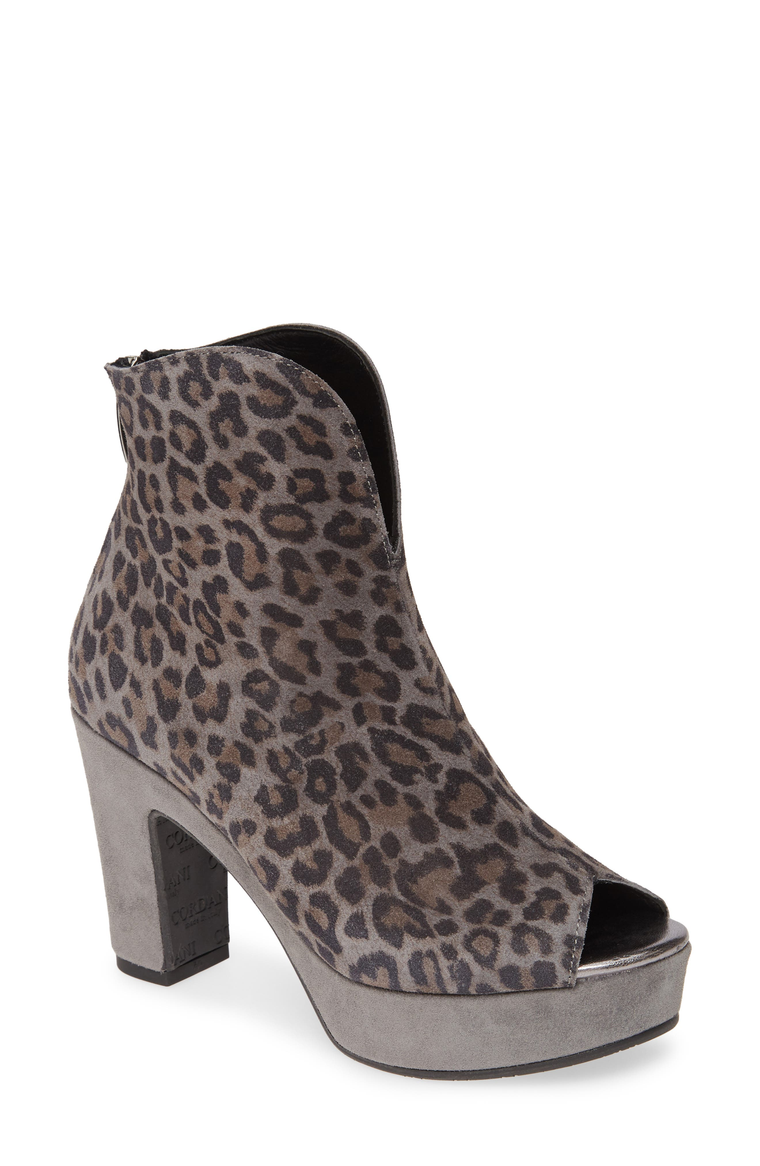 A curving topline complements the rocker bottom that gently propels each step in this stylish peep-toe bootie with a covered heel and platform. Style Name: Cordani Tabbi Peep Toe Bootie (Women). Style Number: 5869221 1. Available in stores.