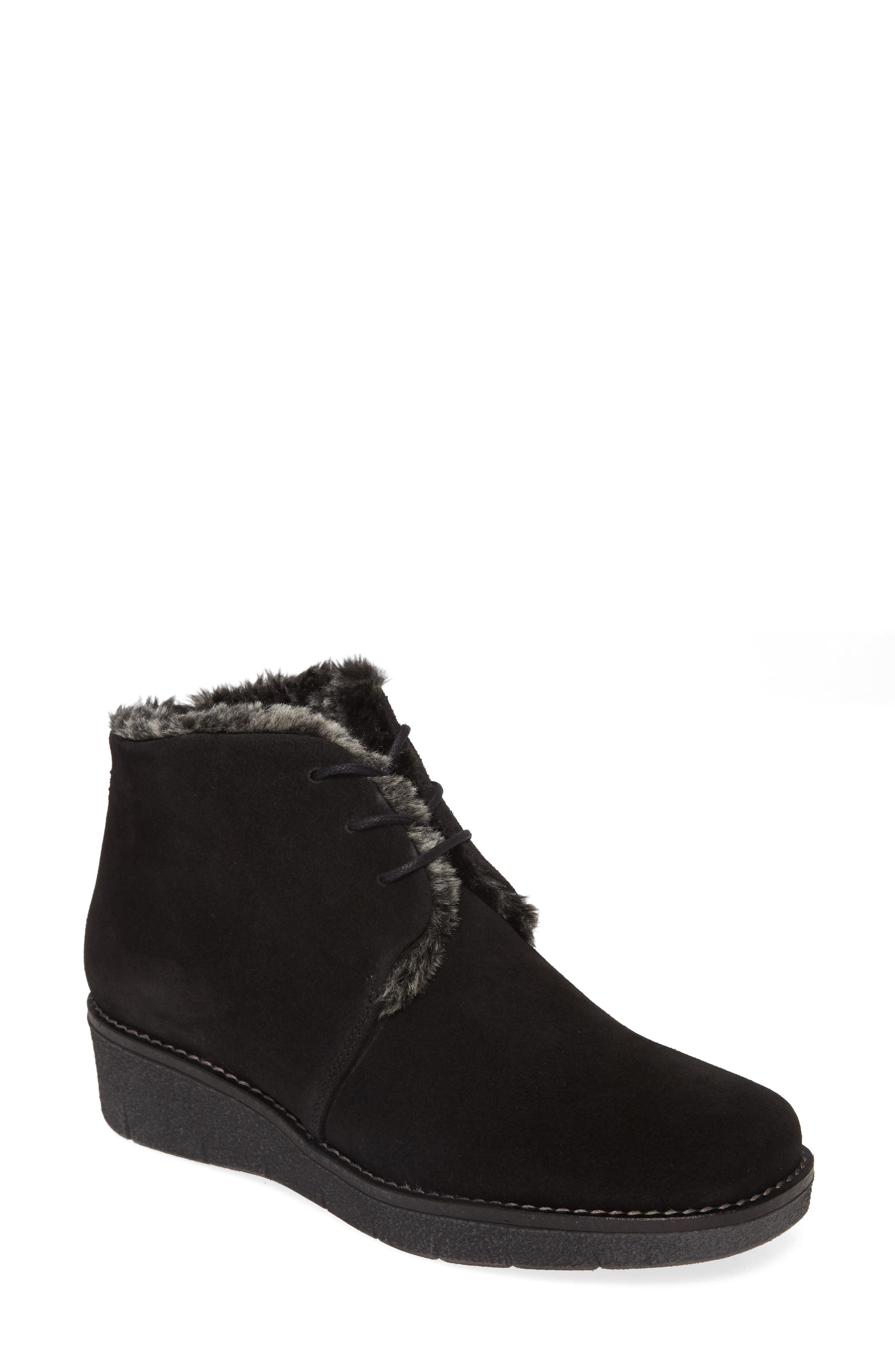 A lace-up bootie on a modest wedge heel offers wintry-chic style with its tufts of soft faux fur peaking out at the shaft. Style Name: Toni Pons Alp Faux Fur Bootie (Women). Style Number: 5916582. Available in stores.
