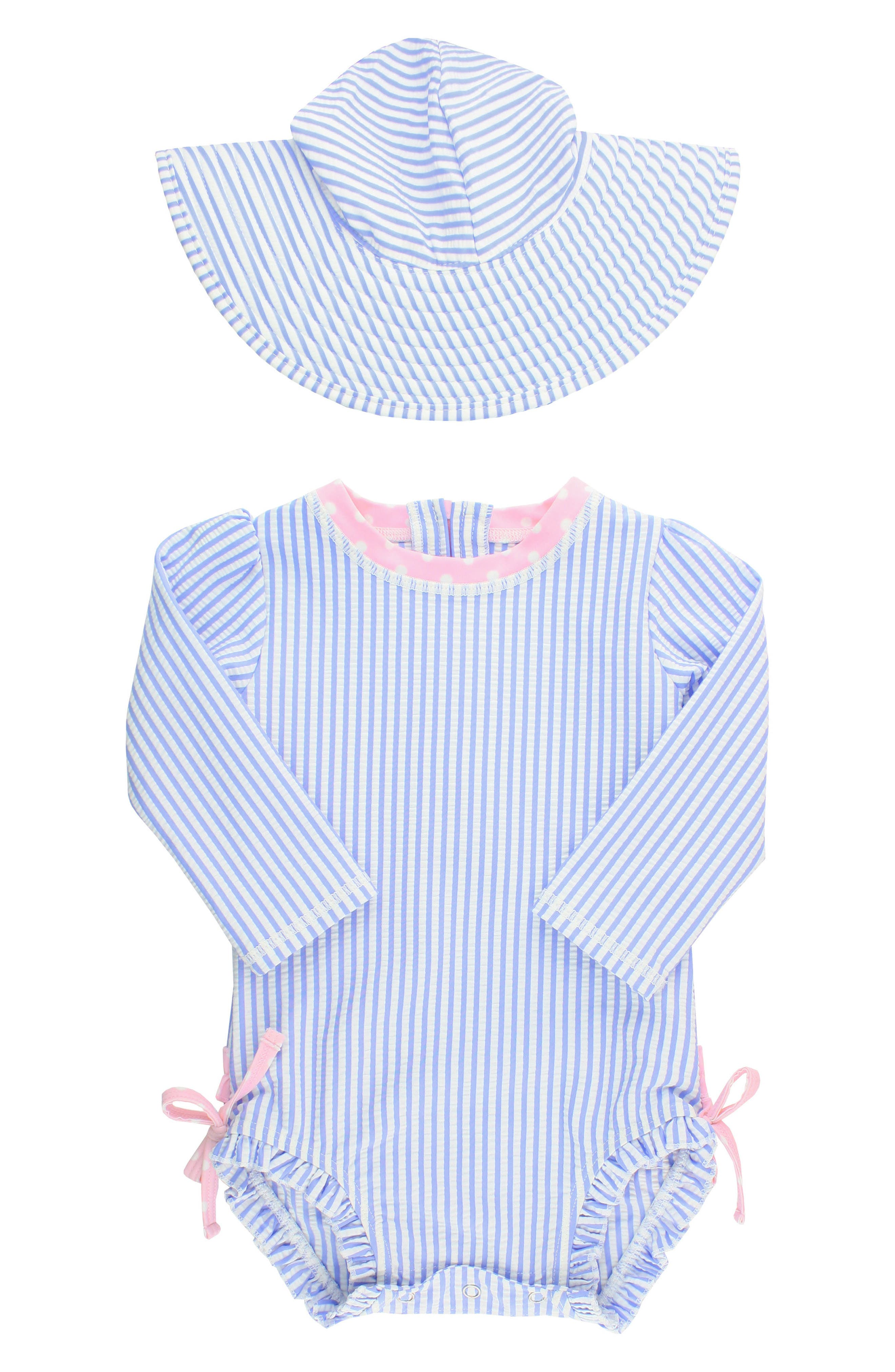 Seersucker stripes and polka-dot pink ruffles define a rashguard swimsuit paired with a striped bucket hat for extra sun protection. Style Name: Rufflebutts Seersucker One-Piece Rashguard Swimsuit & Hat Set (Baby). Style Number: 5598201. Available in stores.