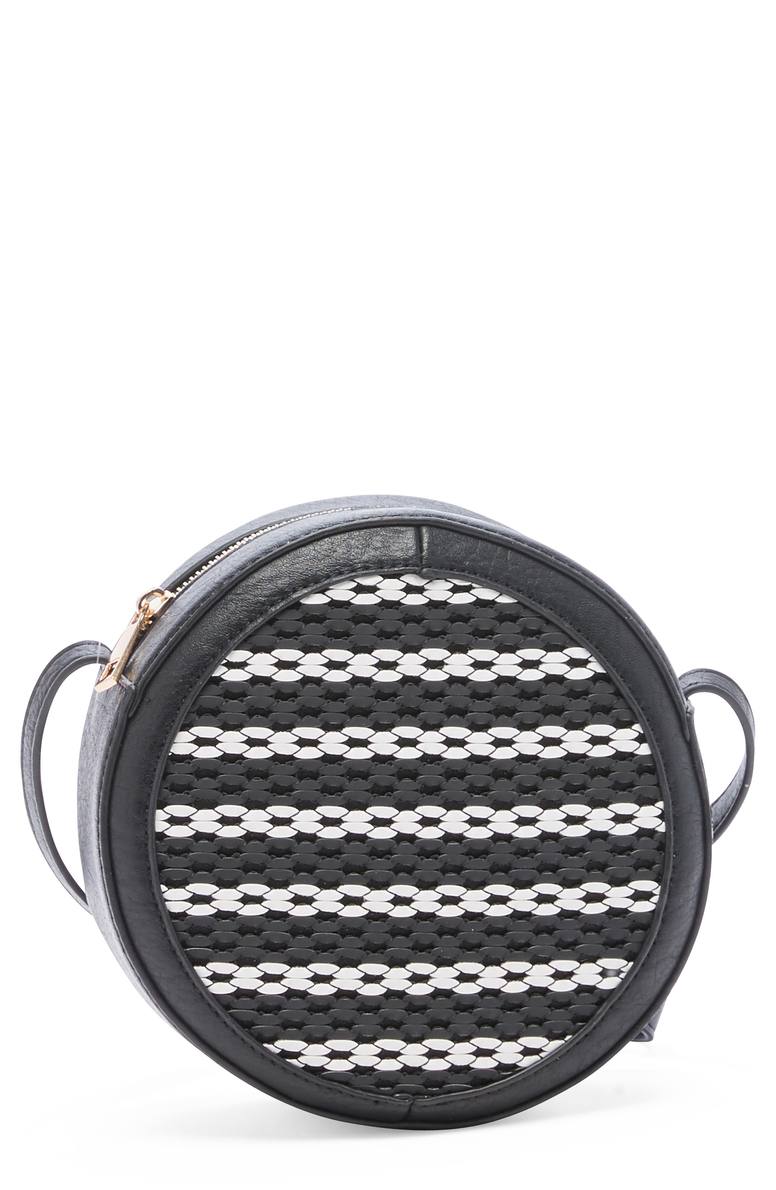 A bold herringbone weave brings texture to this trend-right circle bag designed to be worn crossbody style. Style Name: Sole Society Nikole Mini Circle Crossbody Bag. Style Number: 6023793. Available in stores.