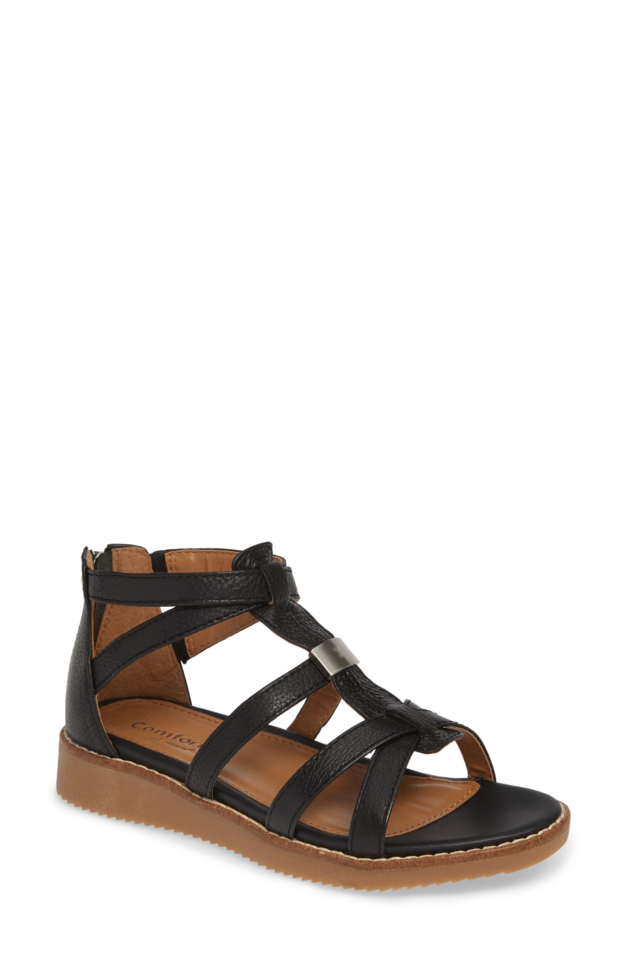 A low wedge heel adds just-right lift to a gladiator-inspired sandal fitted with Comfortiva\\\'s Pillowtop memory foam-cushioned footbed for lasting comfort. Style Name: Comfortiva Wyola Sandal (Women). Style Number: 5807680. Available in stores.