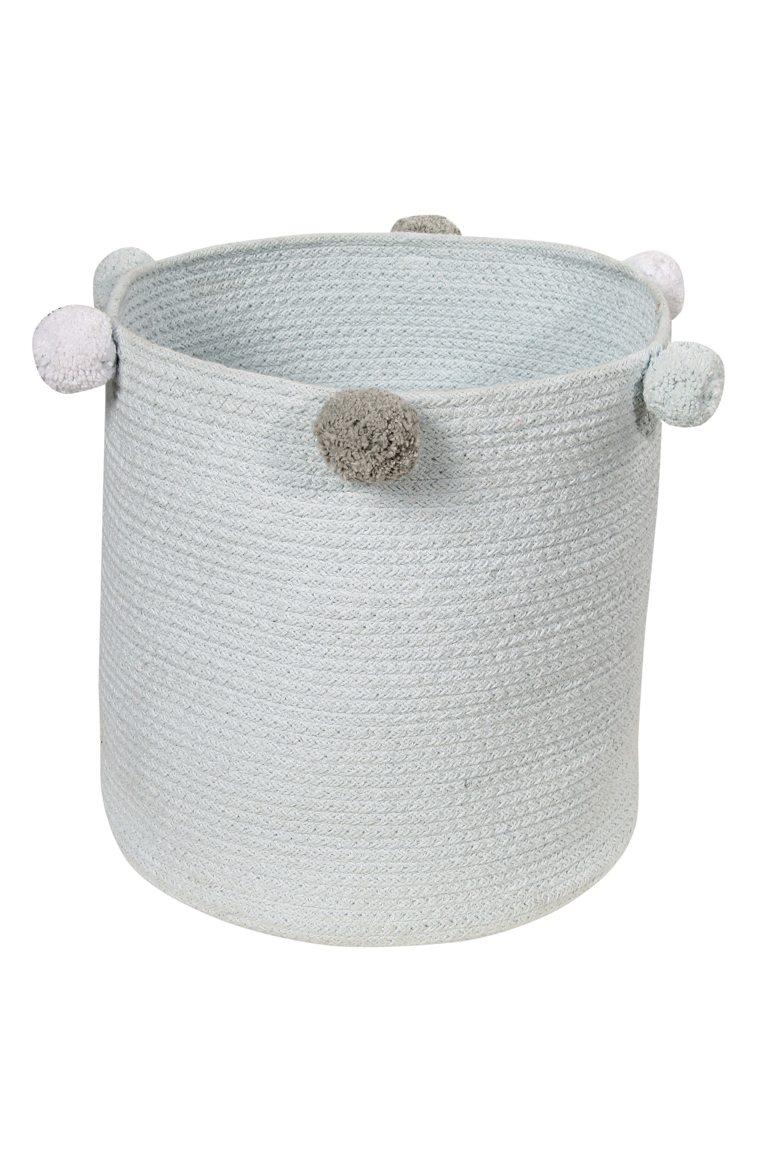 Pompom trim adds a fun flourish to a handmade basket that provides ideal toy storage while making any nursery extra charming. Style Name: Lorena Canals Bubbly Basket. Style Number: 5869426. Available in stores.