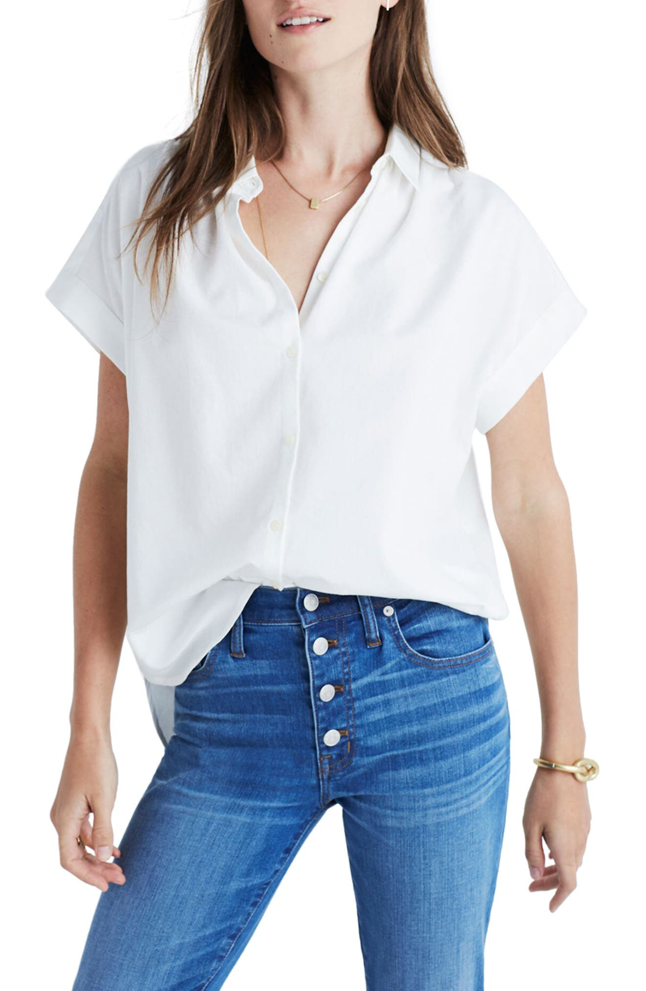 Perfectly slouchy and tailored, this crisp closet-staple blouse has cuffed short sleeves and a cool curved hem. Style Name: Madewell Central Blouse. Style Number: 5290371. Available in stores.