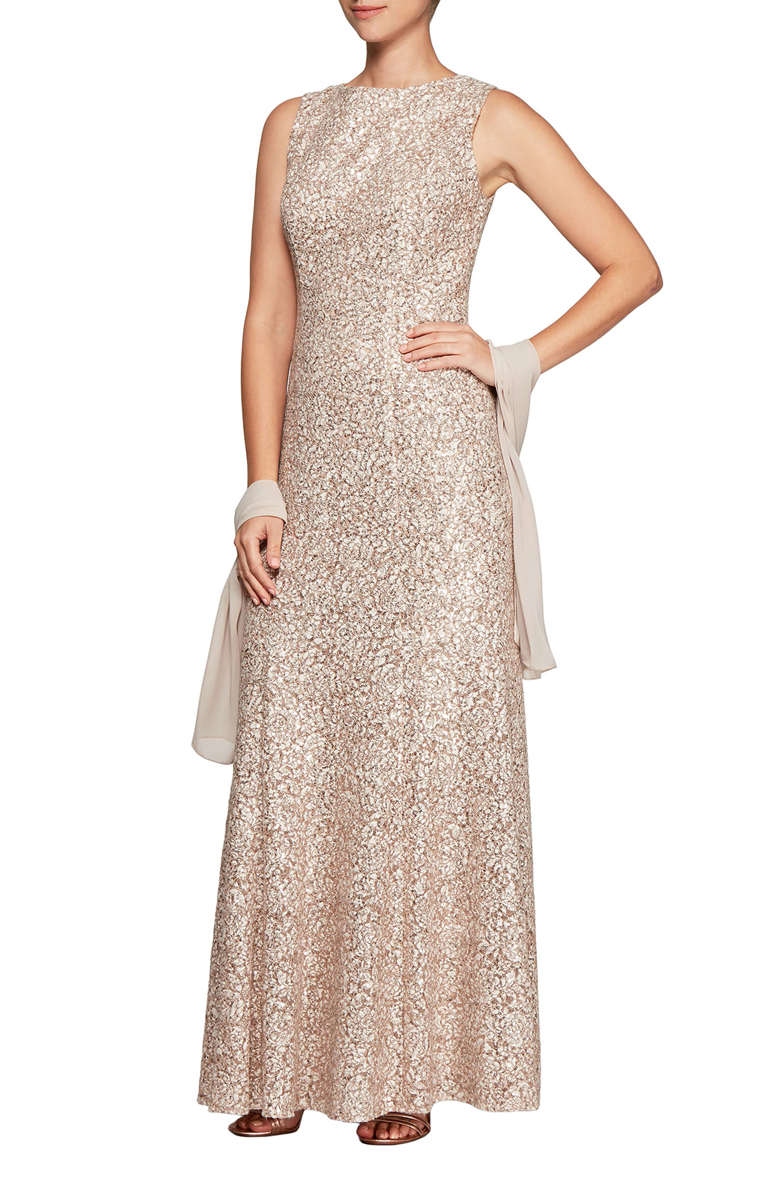 Sequined lace follows the fitted bodice and curve-skimming silhouette of this elegant trumpet gown paired with a filmy shawl for an event-worthy look. Style Name: Alex Evenings Sequin Trumpet Gown With Shawl. Style Number: 6009589. Available in stores.