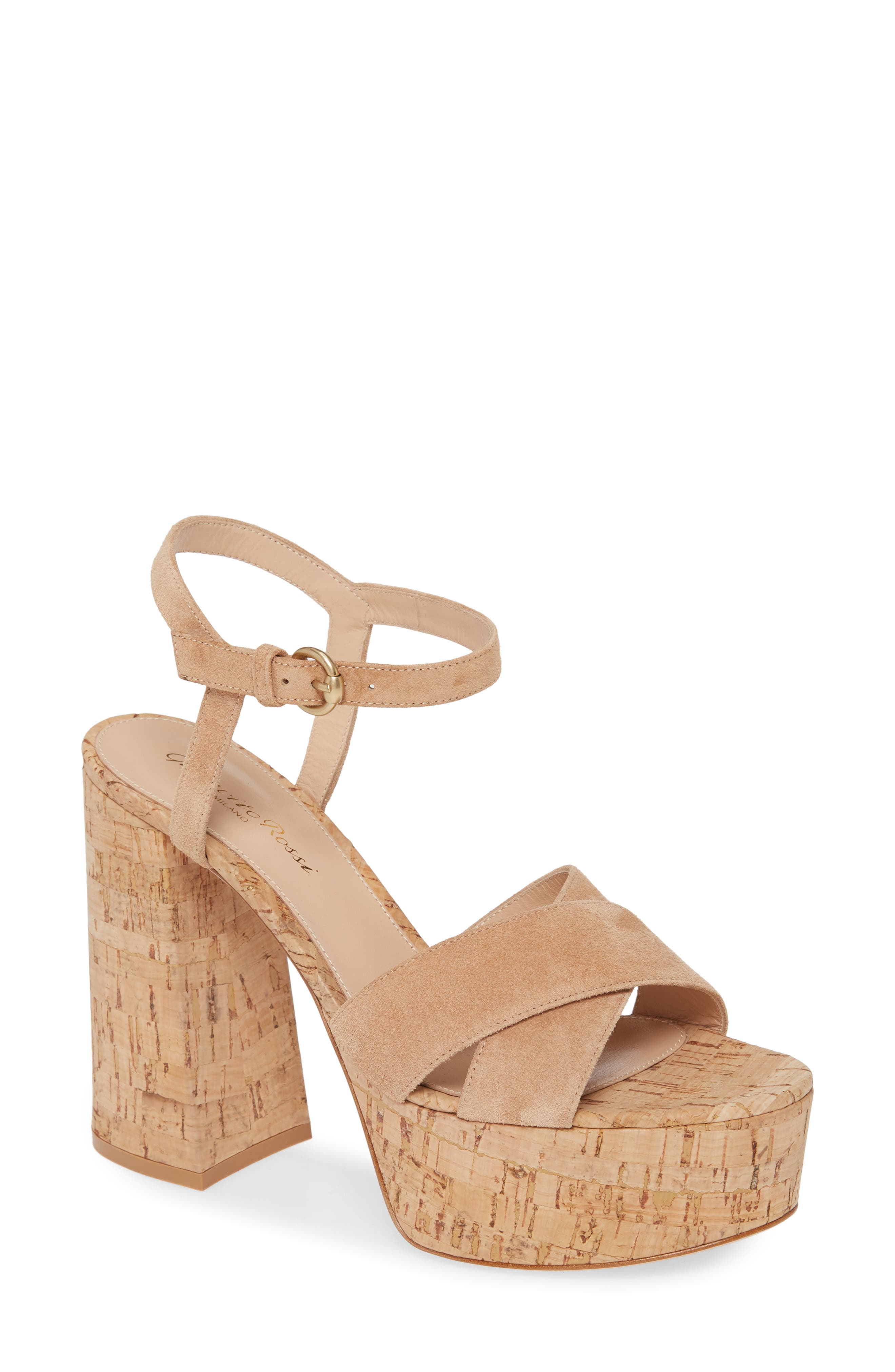 A cork heel and platform dial up the vintage influence of a lofty sandal topped by smooth suede straps. Style Name: Gianvito Rossi Strappy Cork Platform Sandal (Women). Style Number: 5960714. Available in stores.