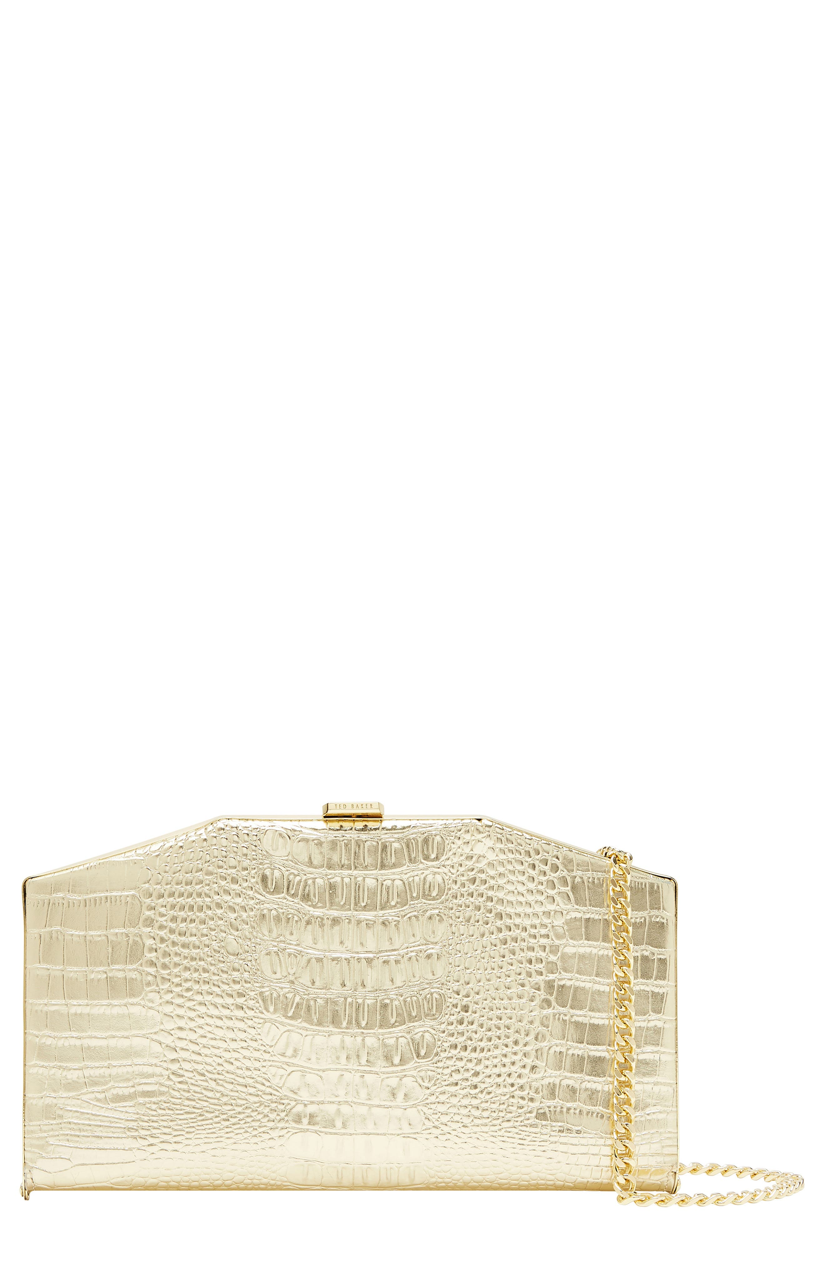 This slimline clutch is framed by golden metal and styled with crocodile embossing and a slinky chain to sling over your shoulder. Style Name: Ted Baker London Unae Croc Embossed Leather Clutch. Style Number: 5997261. Available in stores.