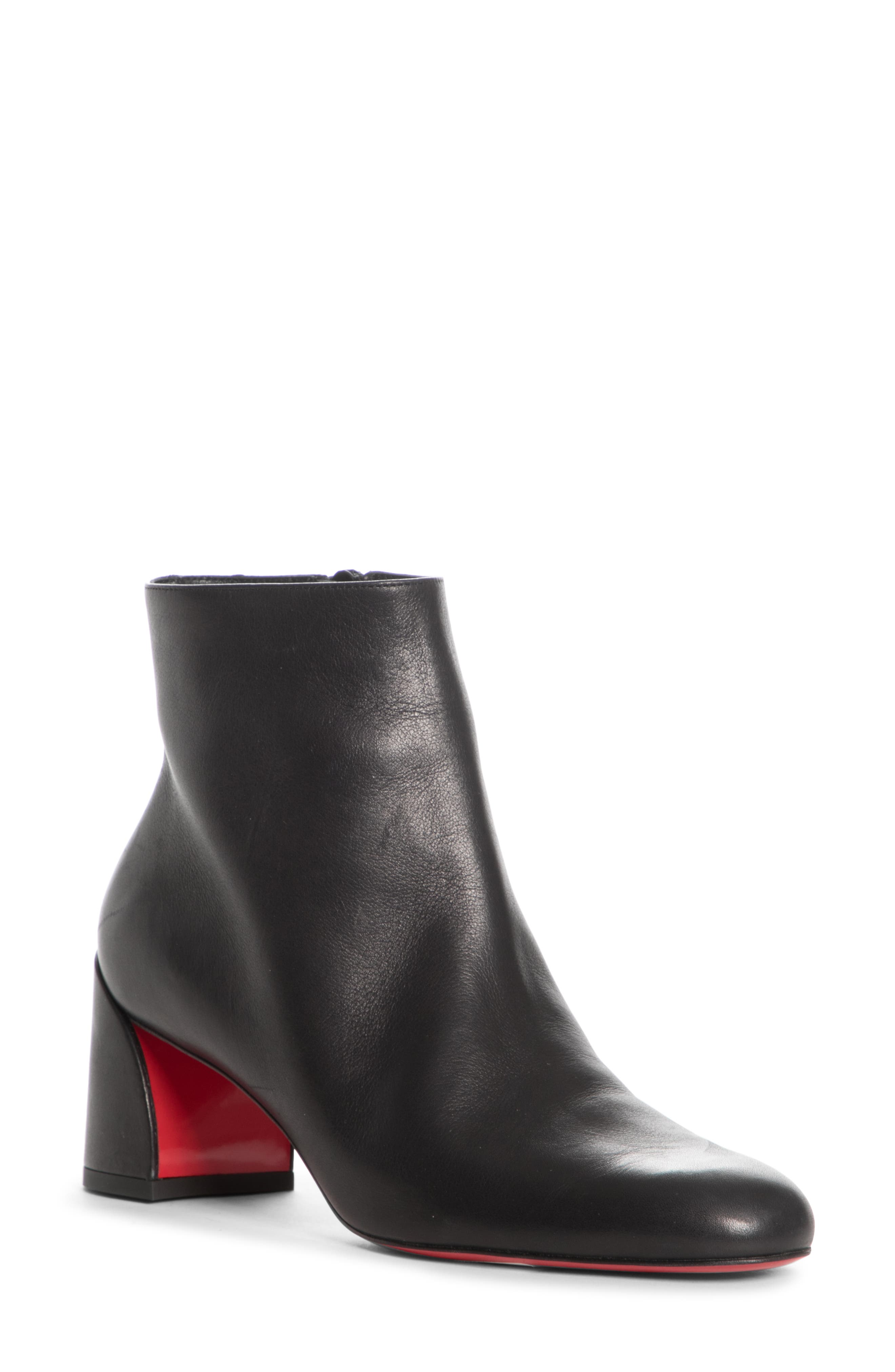 A curvy architectural heel shows off a glimpse of the Louboutin-red sole on this walkable, around-town bootie done in supple Italian leather. Style Name: Christian Louboutin Turela Bootie (Women). Style Number: 5898684. Available in stores.