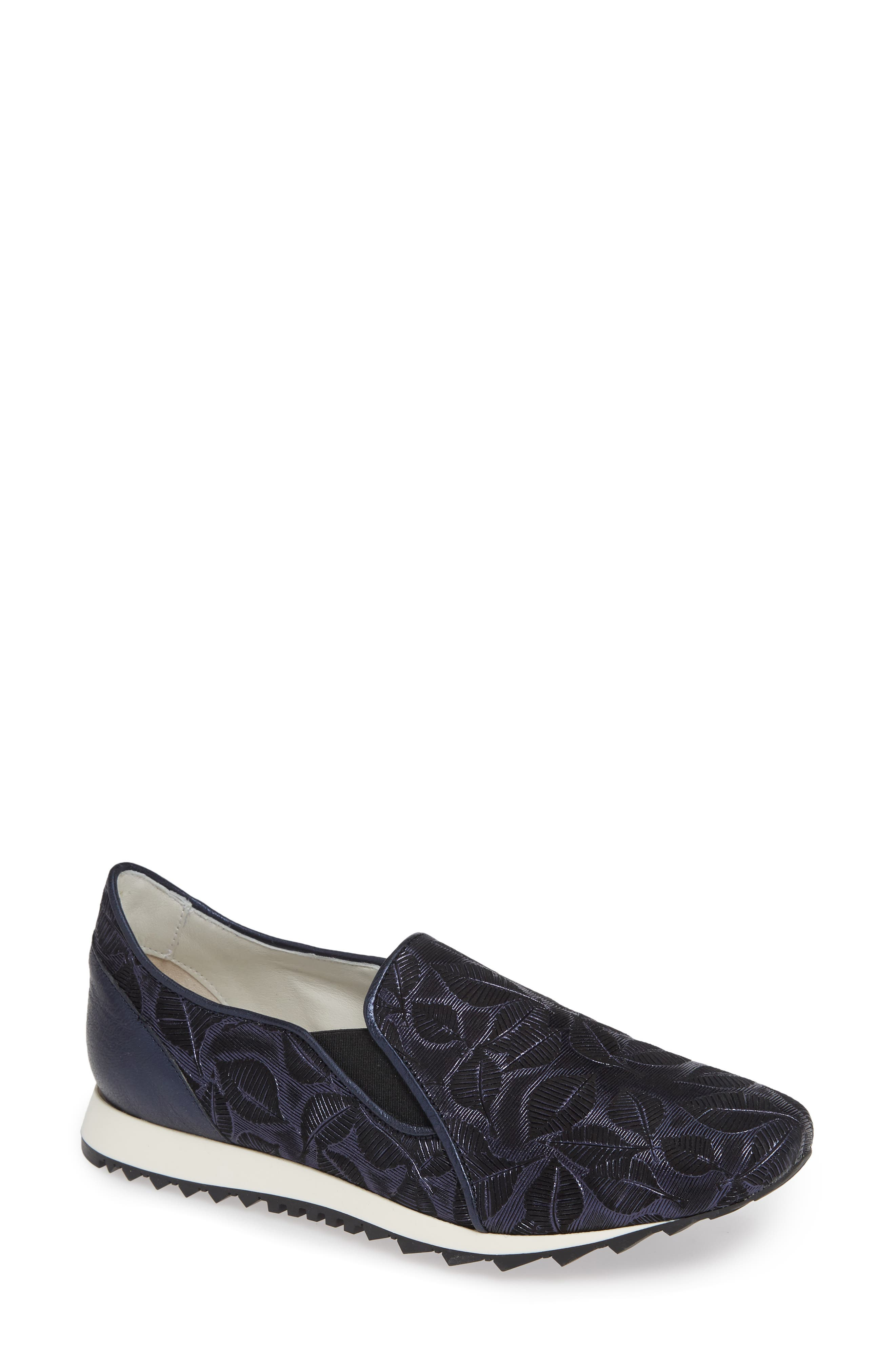 A mesmerizing leaf pattern and a little bit of shimmer update a sporty slip-on sneaker with a tread sole and comfort footbed. Style Name: Amalfi By Rangoni Francia Slip-On Sneaker (Women). Style Number: 5683827. Available in stores.