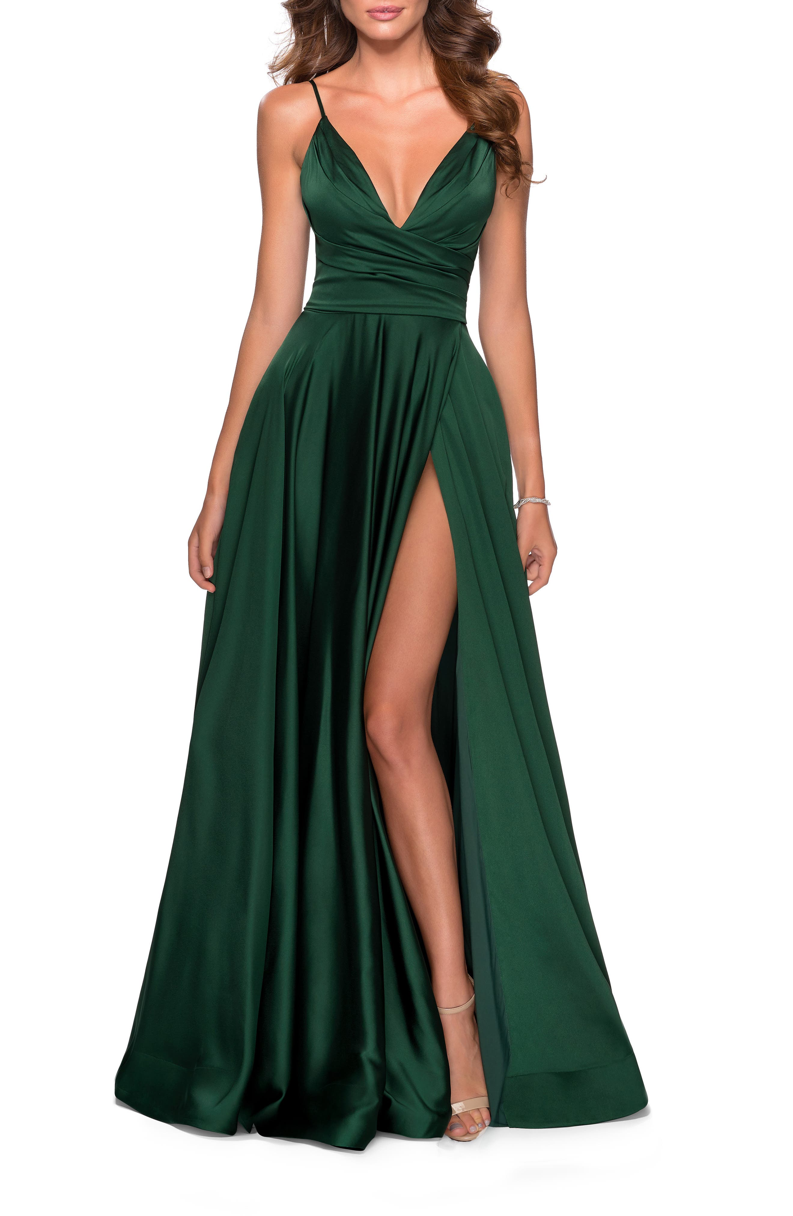 Liquid shimmer pours down this satin ballgown cut with no small measure of daring via a plunging neckline, an open back and an unexpected front slit. Style Name: La Femme Strappy Back Satin Ballgown. Style Number: 6024981. Available in stores.
