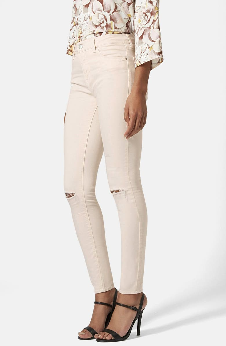 228acc18ad1 Topshop Moto 'Leigh' Ripped Mid Rise Skinny Jeans (Ecru) (Regular ...