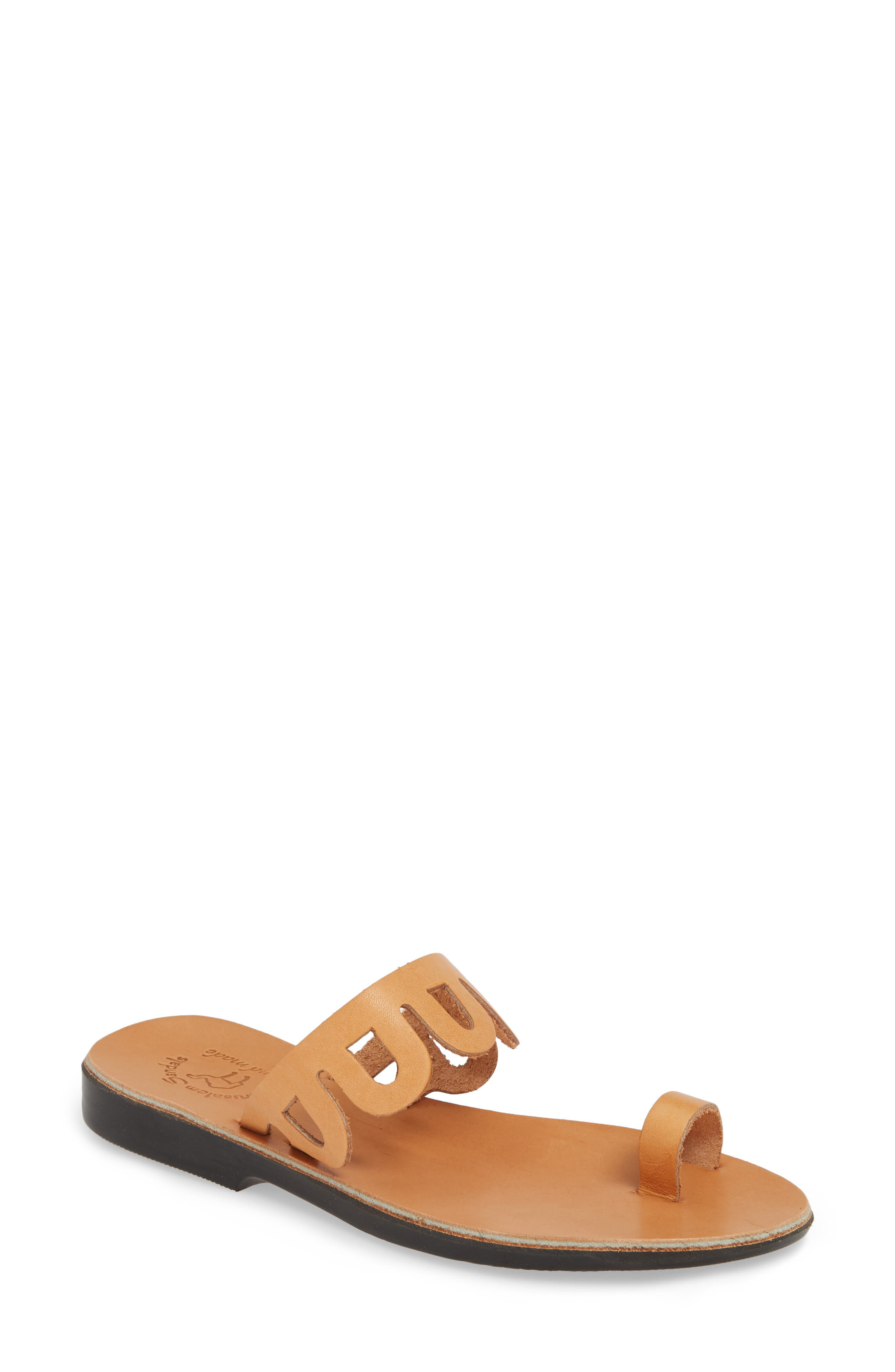 Loopy cutouts look like minimalist lace against the skin in this handcrafted toe-loop sandal made with vegetable-tanned, hypoallergenic leather. Style Name: Jerusalem Sandals Aja Slide Sandal (Women). Style Number: 5790584. Available in stores.