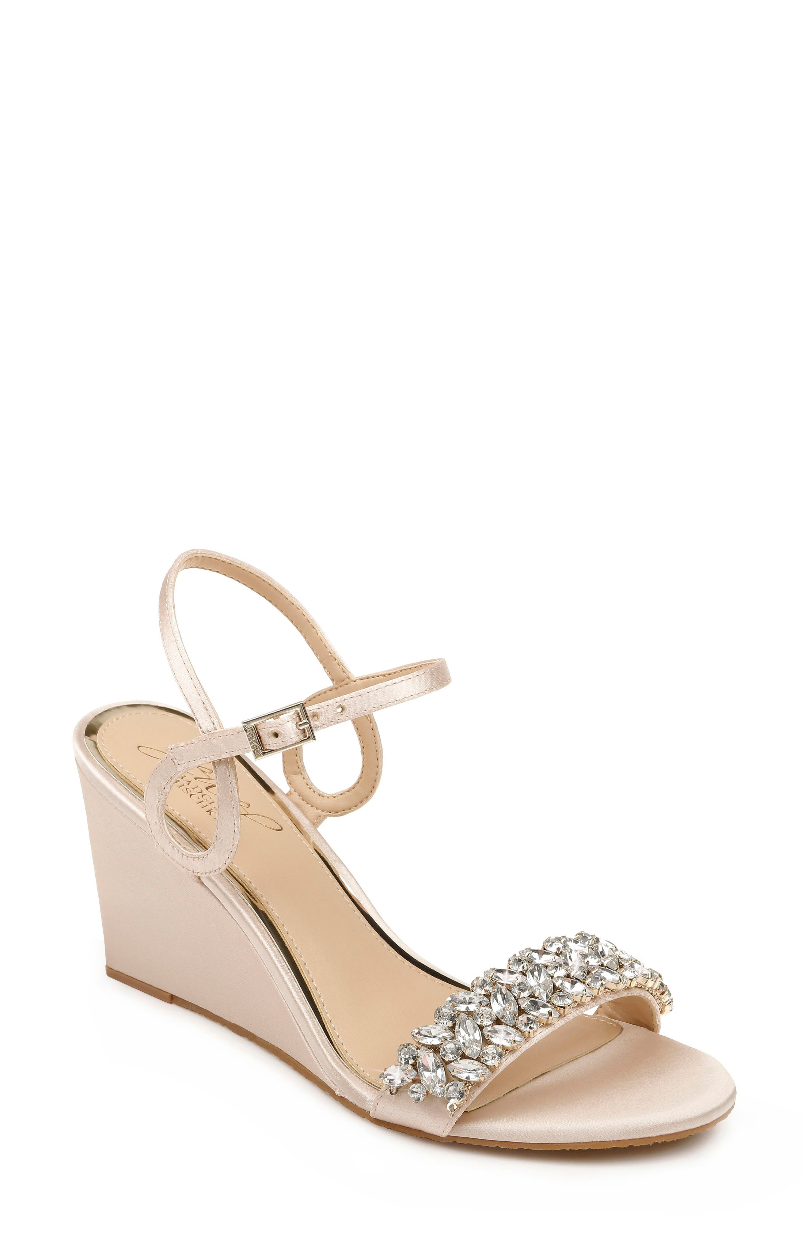 Twinkling crystals dazzle at the toe strap of a wedge-heel sandal finished with a flourish thanks to a curlicue quarter strap. Style Name: Jewel Badgley Mischka Noralie Wedge Sandal (Women). Style Number: 5999002 1. Available in stores.