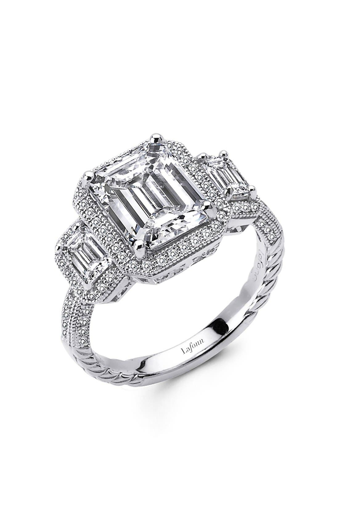 Three emerald-cut simulated diamonds traced with sparkling jewels add timeless glamour to a striking ring that makes the perfect engagement ring for someone special. Style Name: Lafonn \\\'Lassaire\\\' Three Stone Ring. Style Number: 5164259. Available in stores.