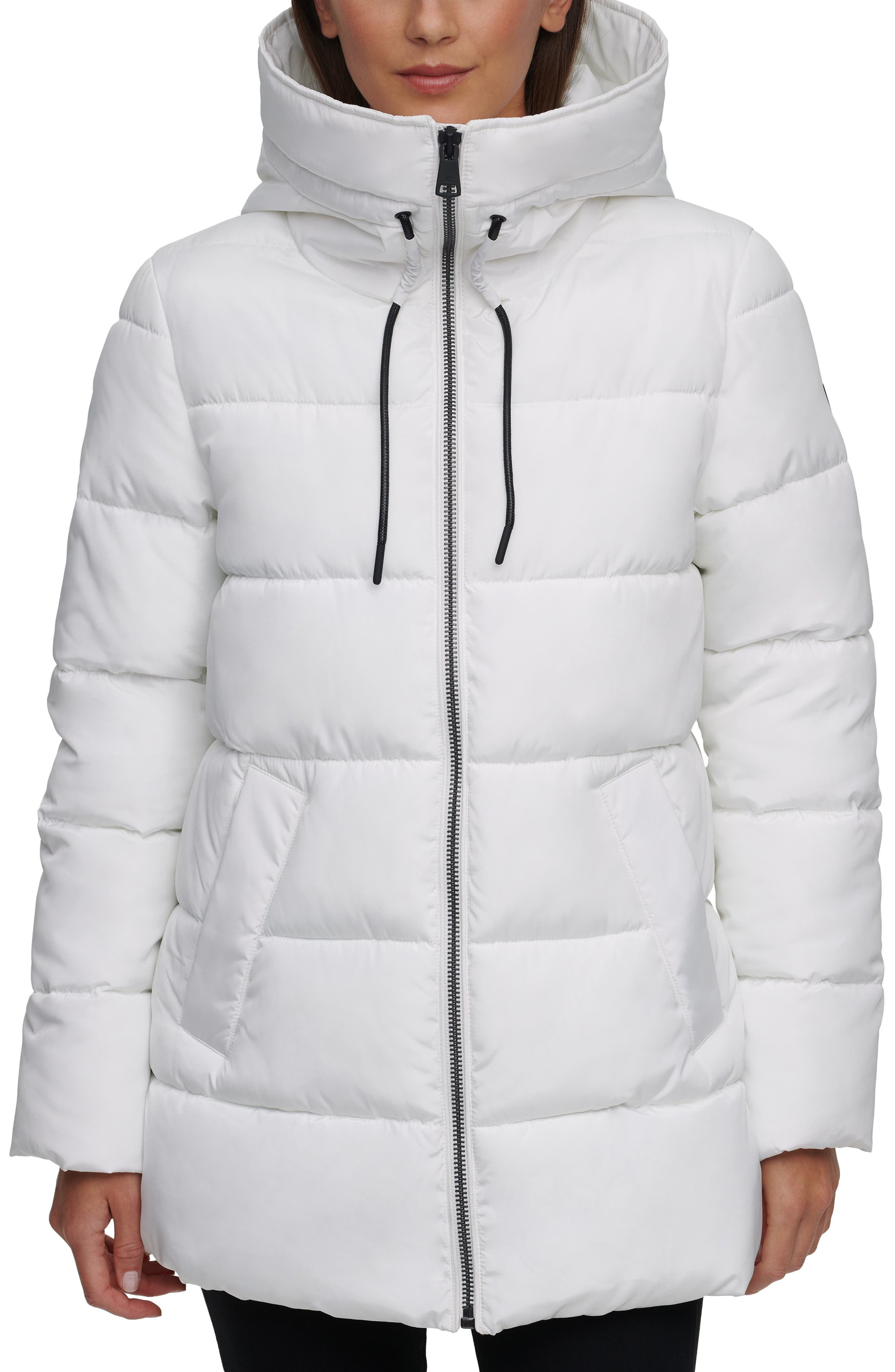 Stay cozy and chic in this lightweight puffer jacket that has a drawcord hood and lets you zip the collar all the way up for extra warmth. Style Name: Kenneth Cole New York Hooded Puffer Jacket (Women). Style Number: 6111984. Available in stores.