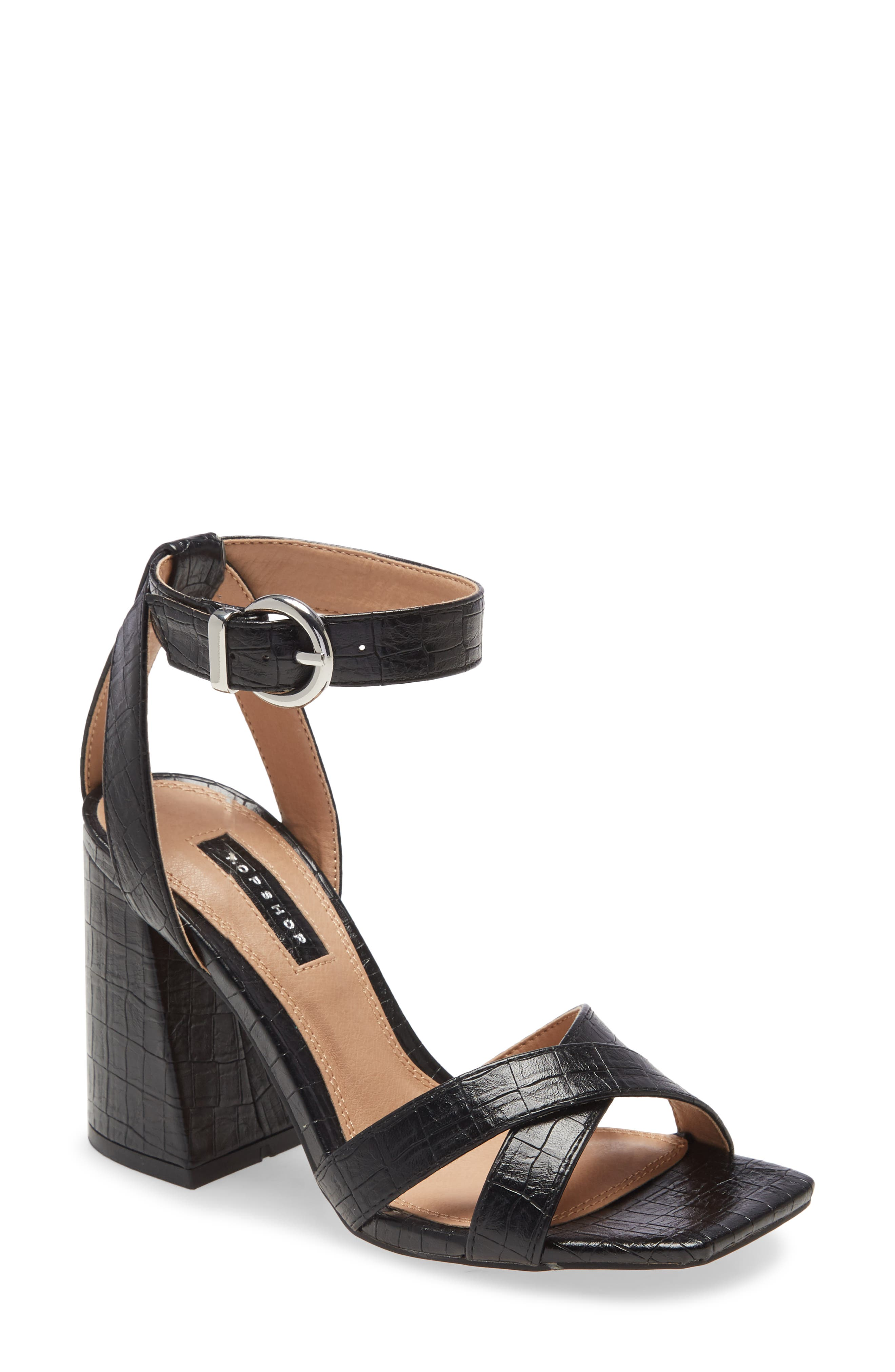 A flared block heel heightens the effect of a strappy sandal finished with glinting hardware and a square toe. Style Name: Topshop Sacha Ankle Strap Block Heel Sandal (Women). Style Number: 6037745. Available in stores.