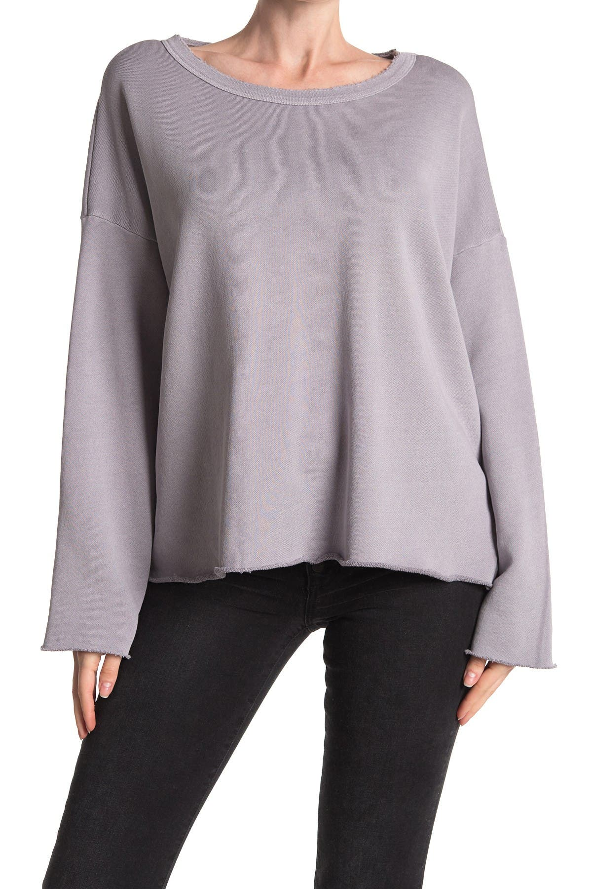 With wide sleeves and a boat neck, this sweater is boxy but cute. Boat neck. Drop shoulder. Wide long sleeves. Woven construction. Solid. Raw hem. Boxy fit. Approx. 25\\\