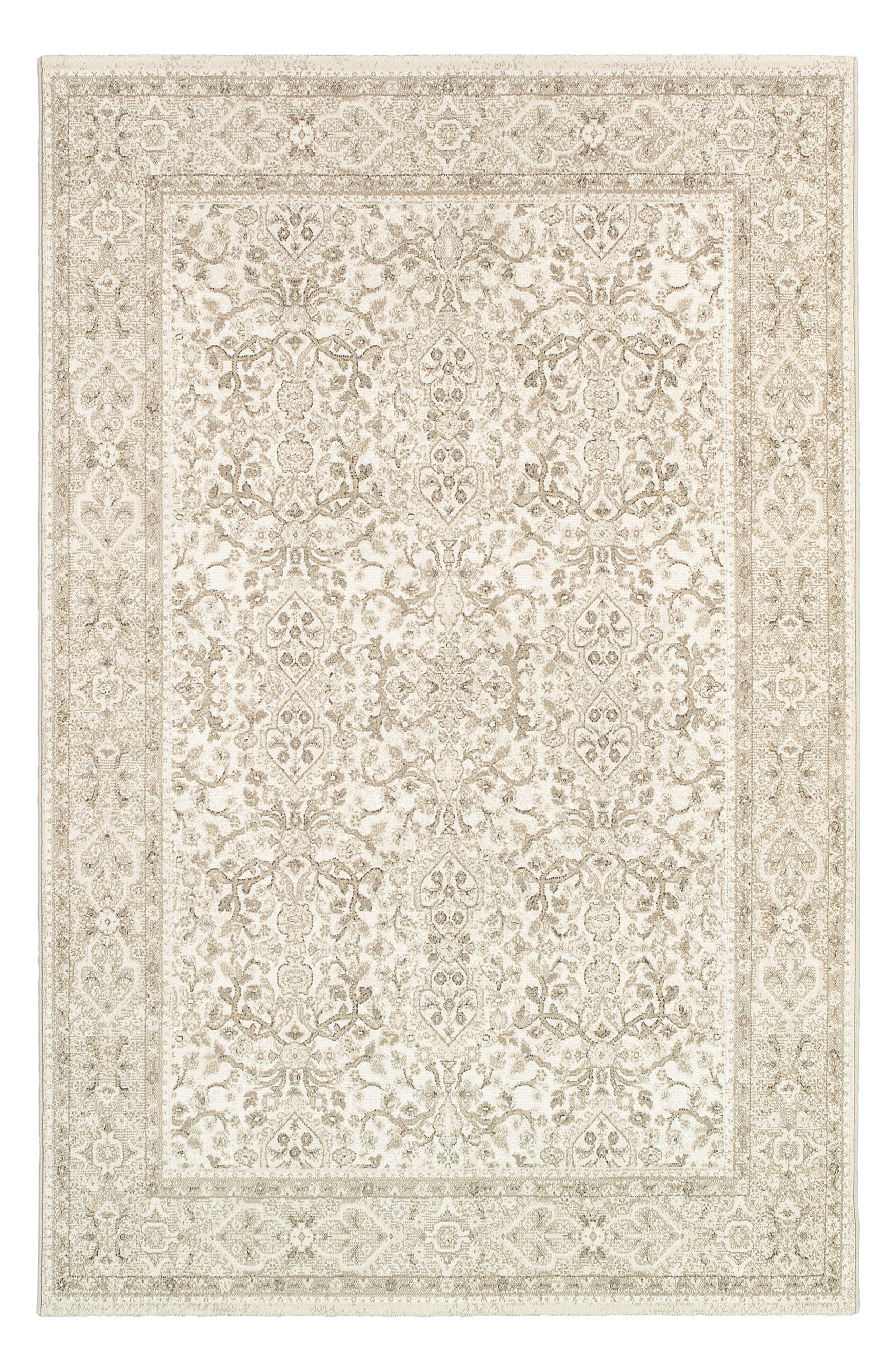A muted, intricate floral motif adds timeless appeal to a versatile rug power-loomed in fade-resistant polypropylene, making it great for high-traffic areas both inside and outside. Style Name: Couristan St. Tropez Indoor/outdoor Rug. Style Number: 5366890. Available in stores.