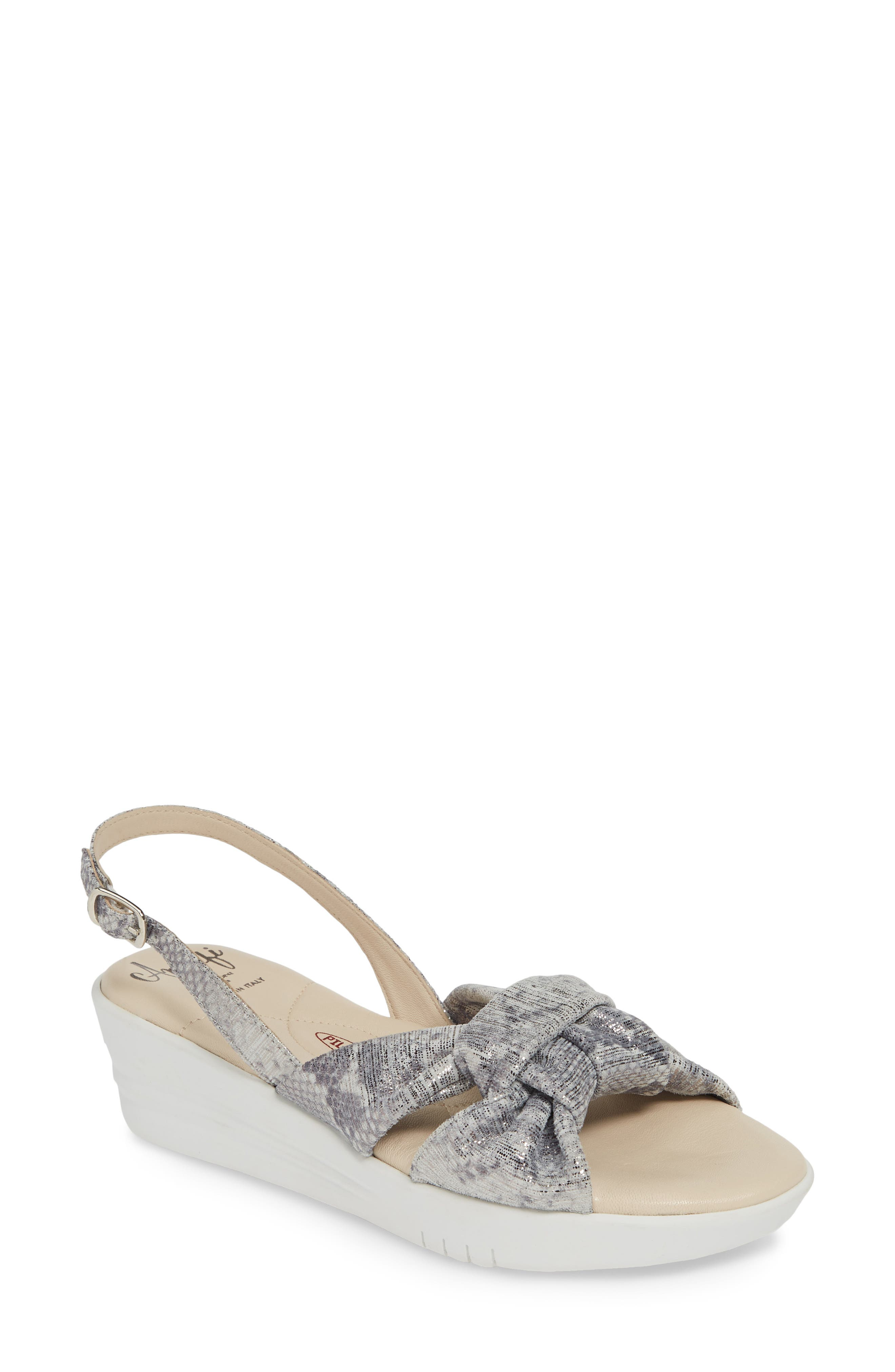 Shot through with metallic foil, this slingback sandal balances shimmery straps with a sporty wedge heel, while a cushy footbed adds comfort to the style. Style Name: Amalfi By Rangoni Gioconda Slingback Wedge Sandal (Women). Style Number: 5795959 1. Available in stores.