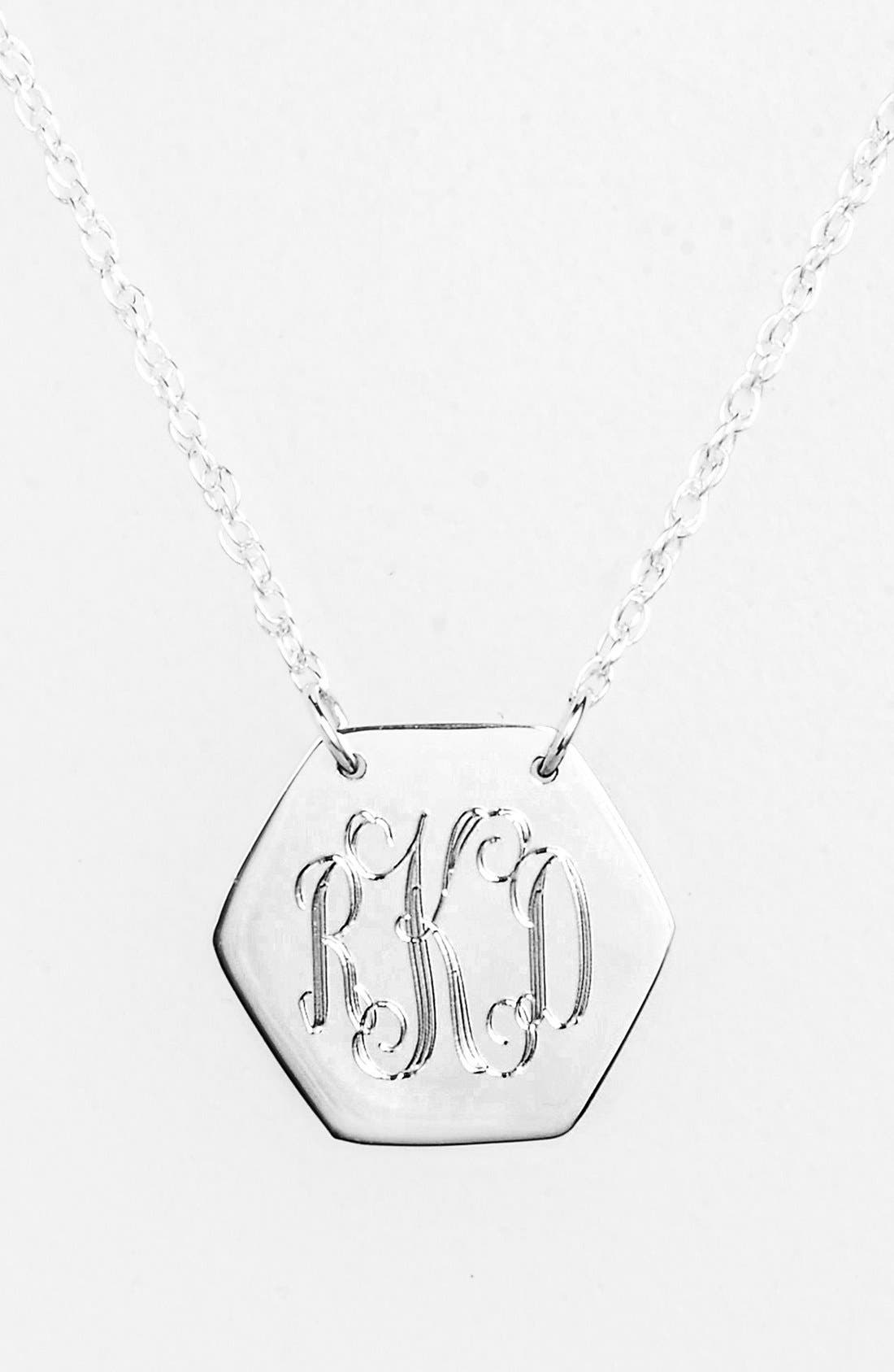 Personalize your own monogrammed necklace with this dainty engraved hexagon pendant. Hand-cut and hand-polished, this customized treasure is sure to be a delightful gift. Style Name: Jane Basch Designs Personalized Hexagon Pendant Necklace. Style Number: 1015559. Available in stores.