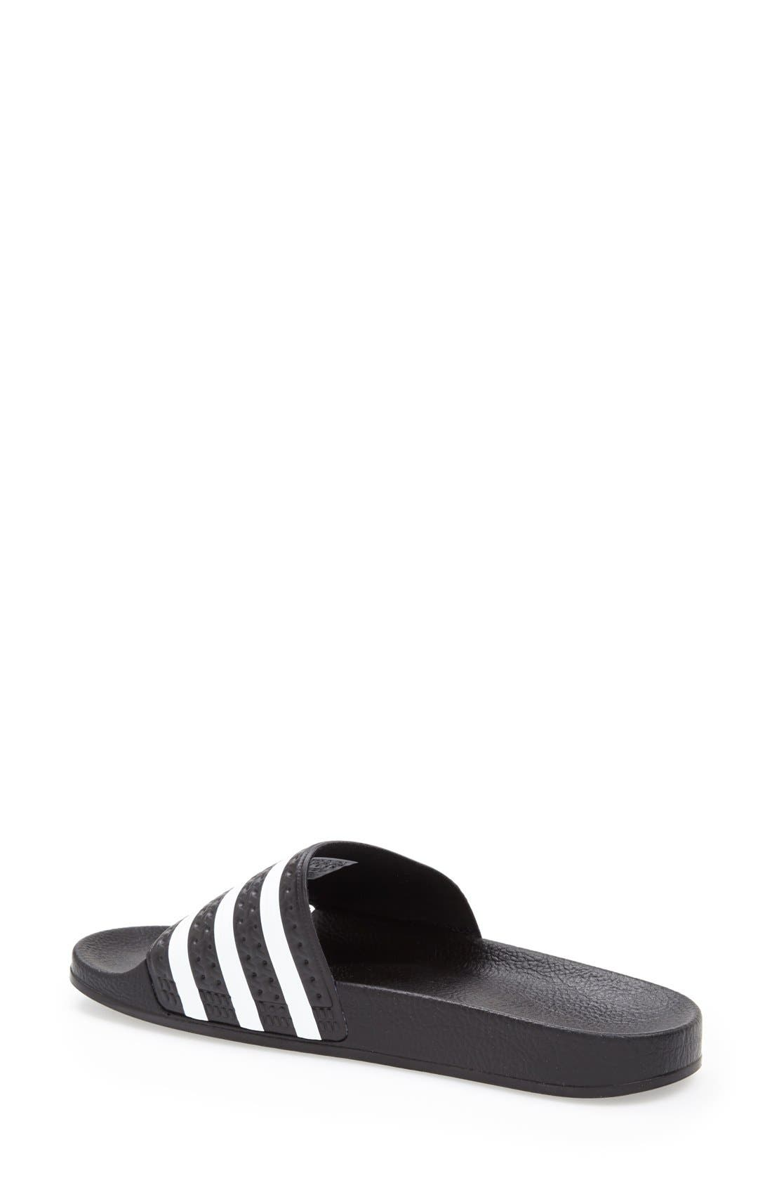 ,                             'Adilette' Slide Sandal,                             Alternate thumbnail 4, color,                             BLACK/ WHITE