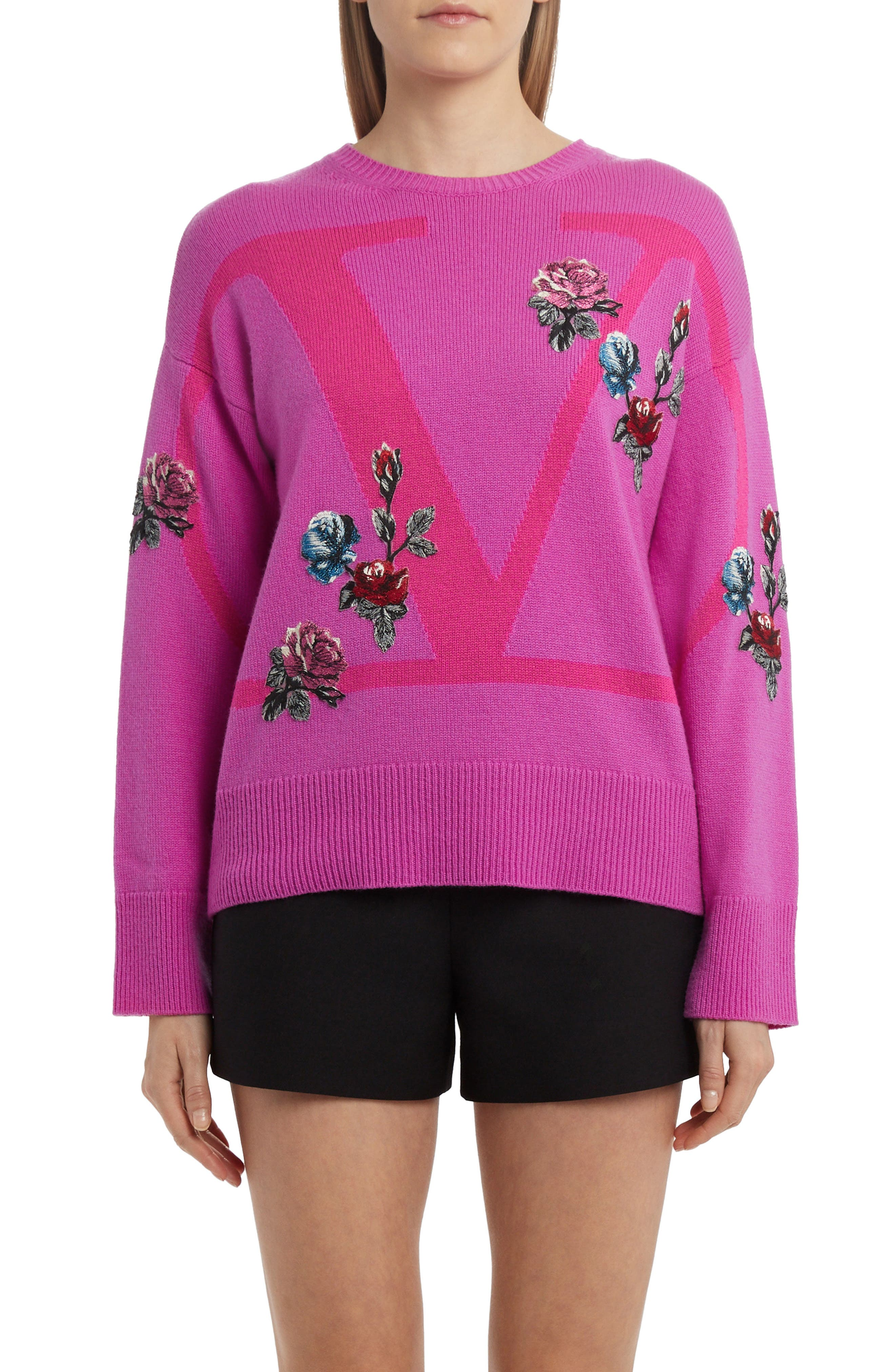 A relaxed, oversized fit modernizes this cashmere crewneck pullover that strikes a signature romantic note with flowery appliques and succulent berry hues. Style Name: Valentino Rose Applique Logo Cashmere Sweater. Style Number: 6013655. Available in stores.