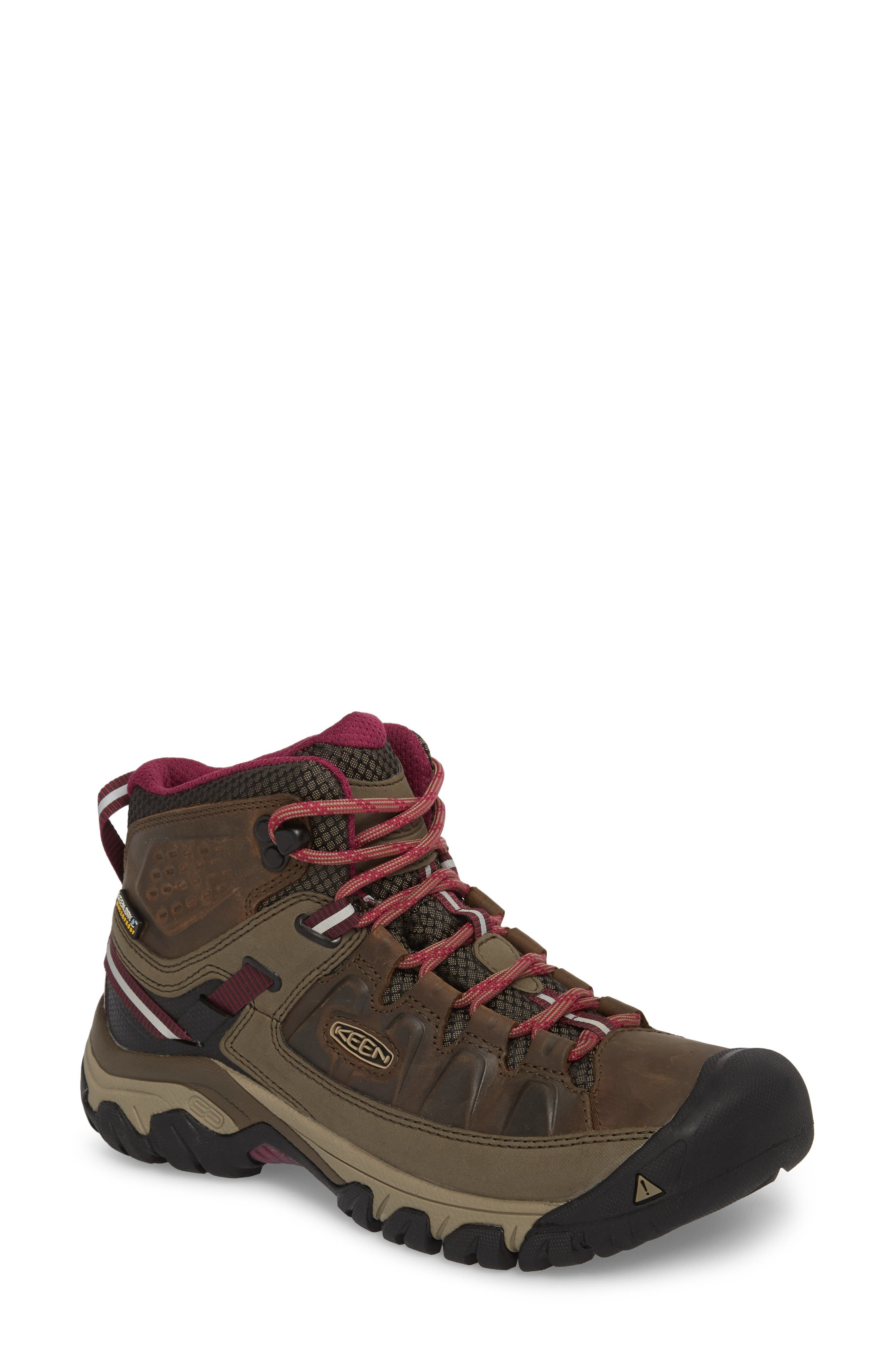 A durable lace-up hiking boot offers excellent traction and features a waterproof KEEN. Dry lining to keep feet free from uncomfortable moisture. Multidensity cushioning and arch support enhance comfort. Style Name: Keen Targhee Iii Mid Waterproof Hiking Boot (Women). Style Number: 5544386 1. Available in stores.