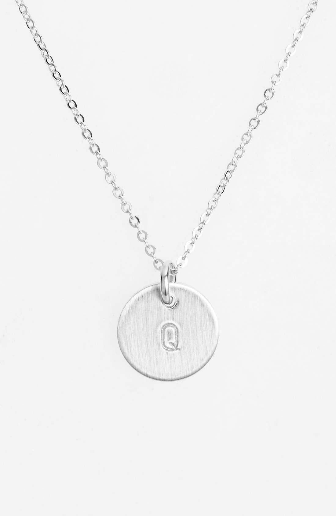 From humble beginnings to a fully staffed warehouse in Bend, Oregon, Nashelle remains true to its original purpose-handmade jewelry crafted with love and intention. The mini-initial necklace is no different, with a small hand-stamped pendant suspended from a delicate chain for a dainty effect. Style Name: Nashelle Sterling Silver Initial Mini Disc Necklace. Style Number: 1016123. Available in stores.