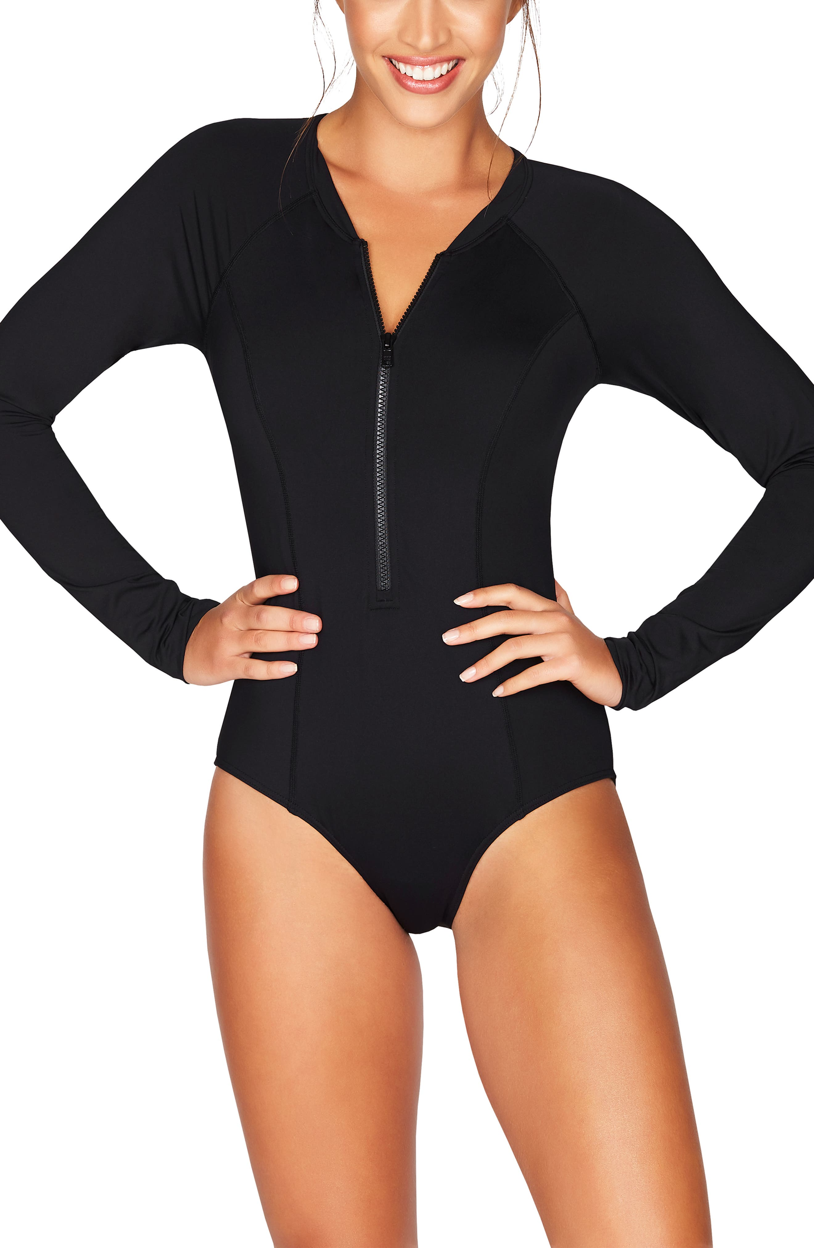 Sleek and sophisticated, this long-sleeved swimsuit is styled with a tonal front zip and power-mesh support. Style Name: Sea Level Front Zip One-Piece Swimsuit. Style Number: 5809999. Available in stores.