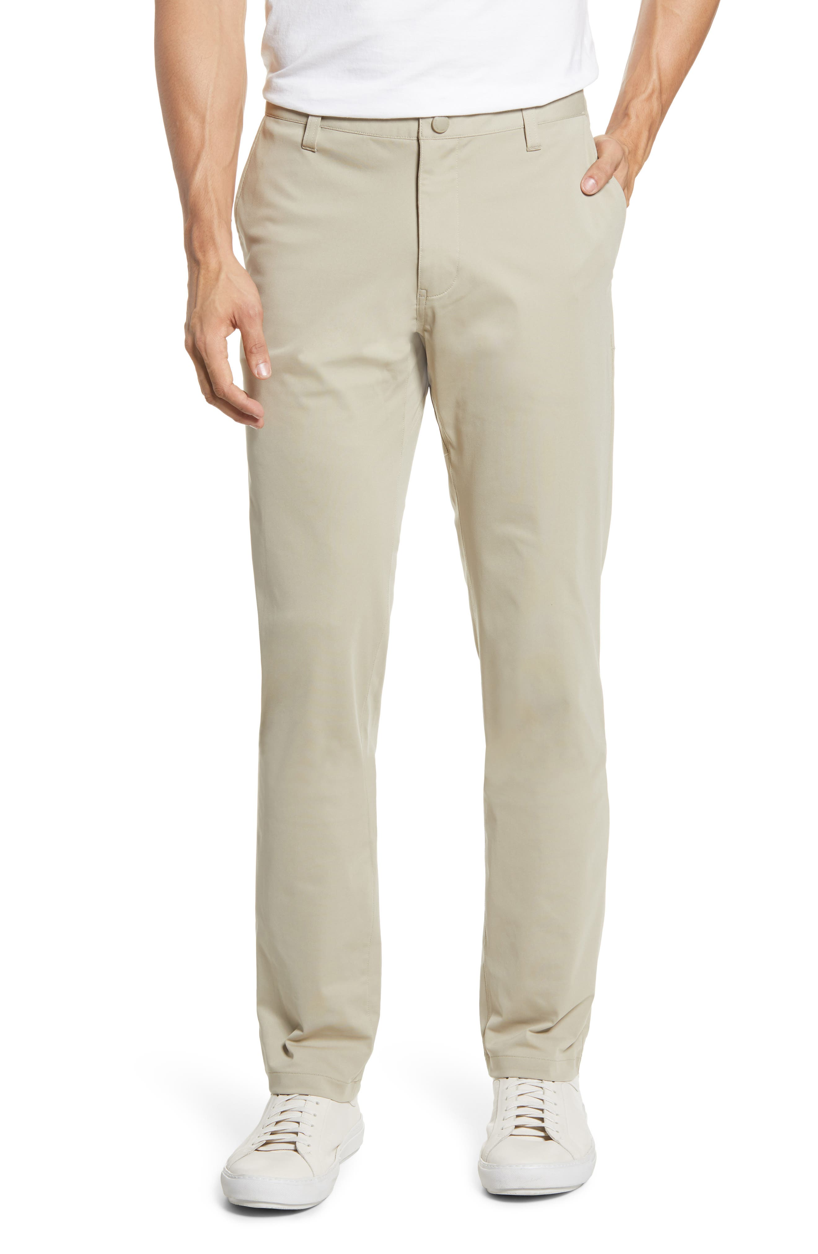 A flat front and modern slim fit take you anywhere in comfortable four-way-stretch pants fitted with secure hidden pockets for your phone, currency or tunes. Style Name: Rhone Commuter Slim Fit Pants. Style Number: 5892451. Available in stores.