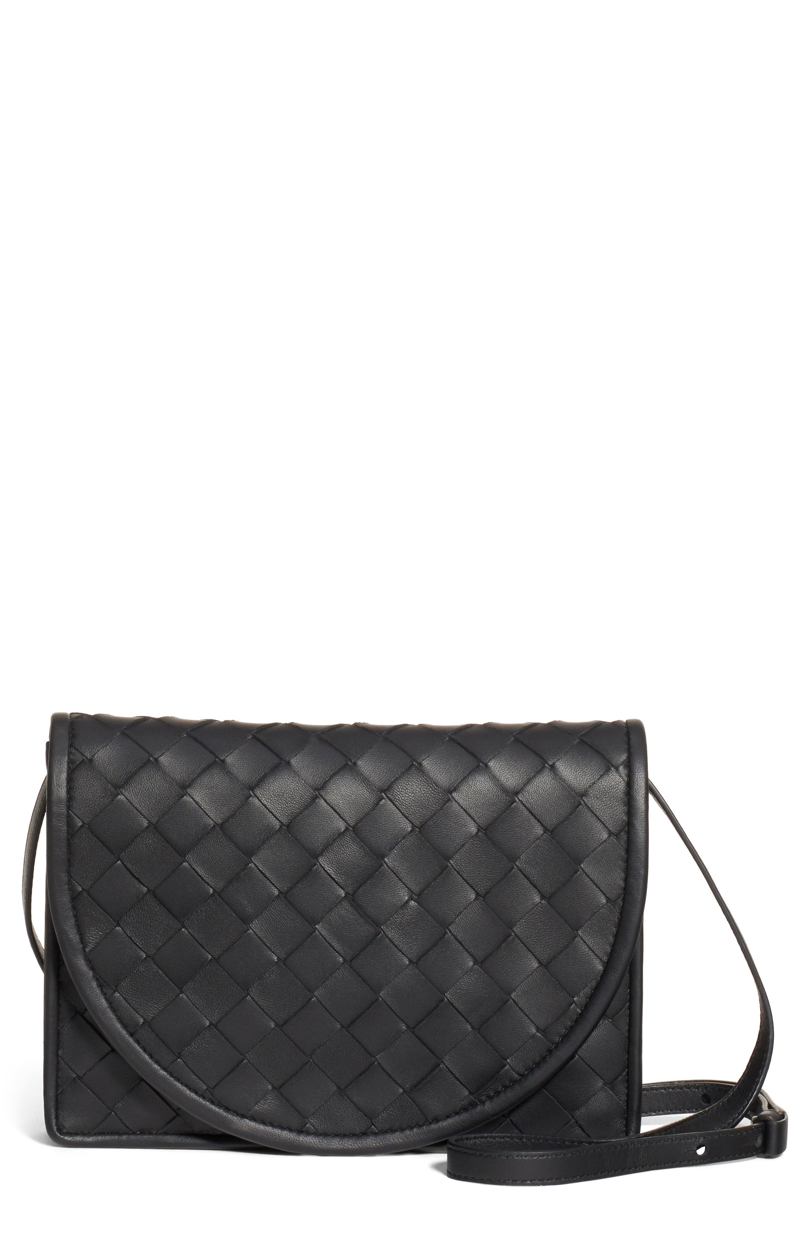 The label\\\'s iconic intrecciato motif brings intriguing dimension to a luxe leather wallet furnished with an optional crossbody strap for hands-free styling. Style Name: Bottega Veneta Intrecciato Leather Wallet On A Strap. Style Number: 5844865. Available in stores.
