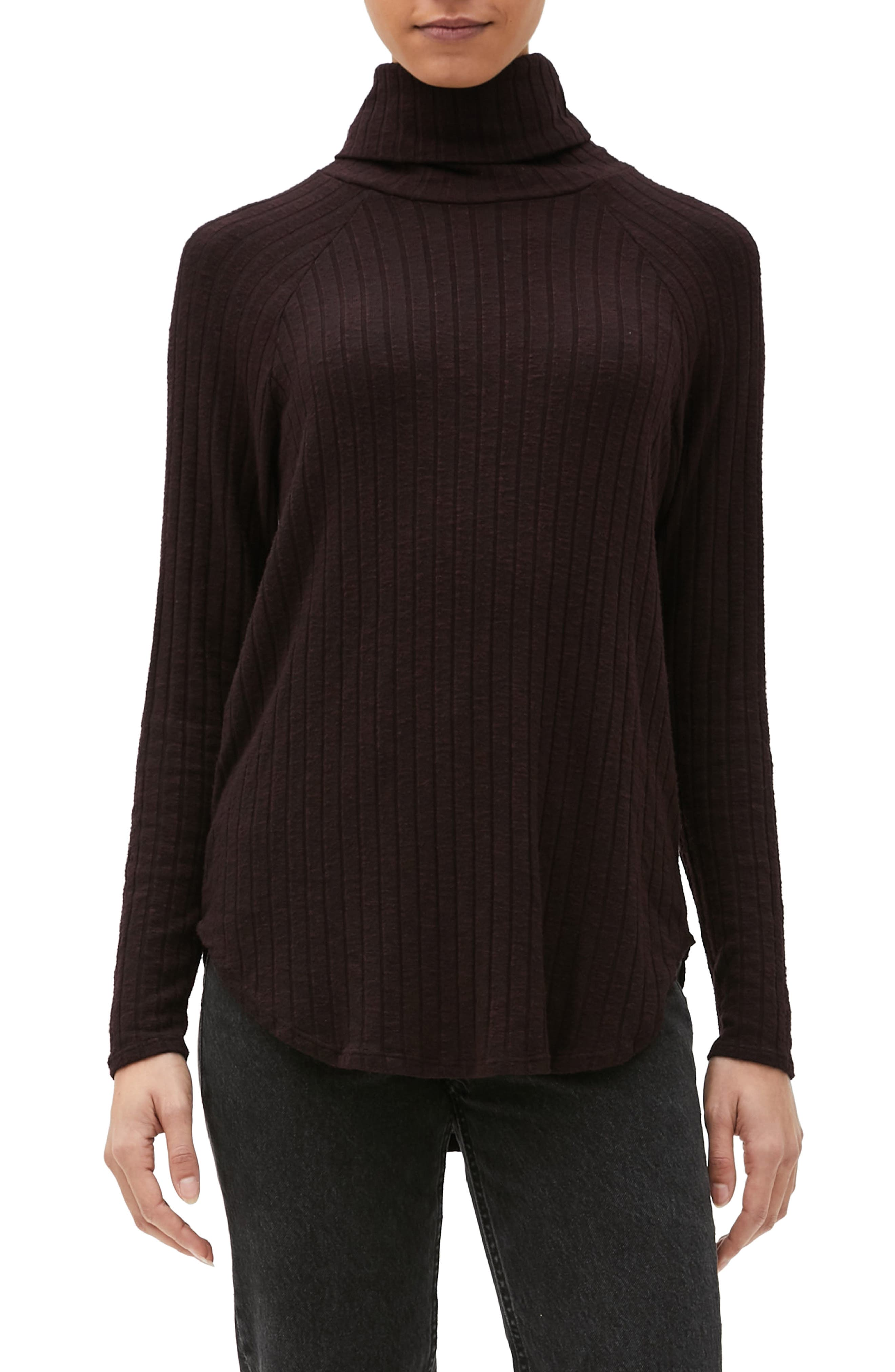 A versatile, solid-colored turtleneck is headed right for regular rotation thanks to its wide ribbed texture and curved high/low hemline. Style Name: Michael Stars Amelia Ribbed Turtleneck Top. Style Number: 6111129. Available in stores.