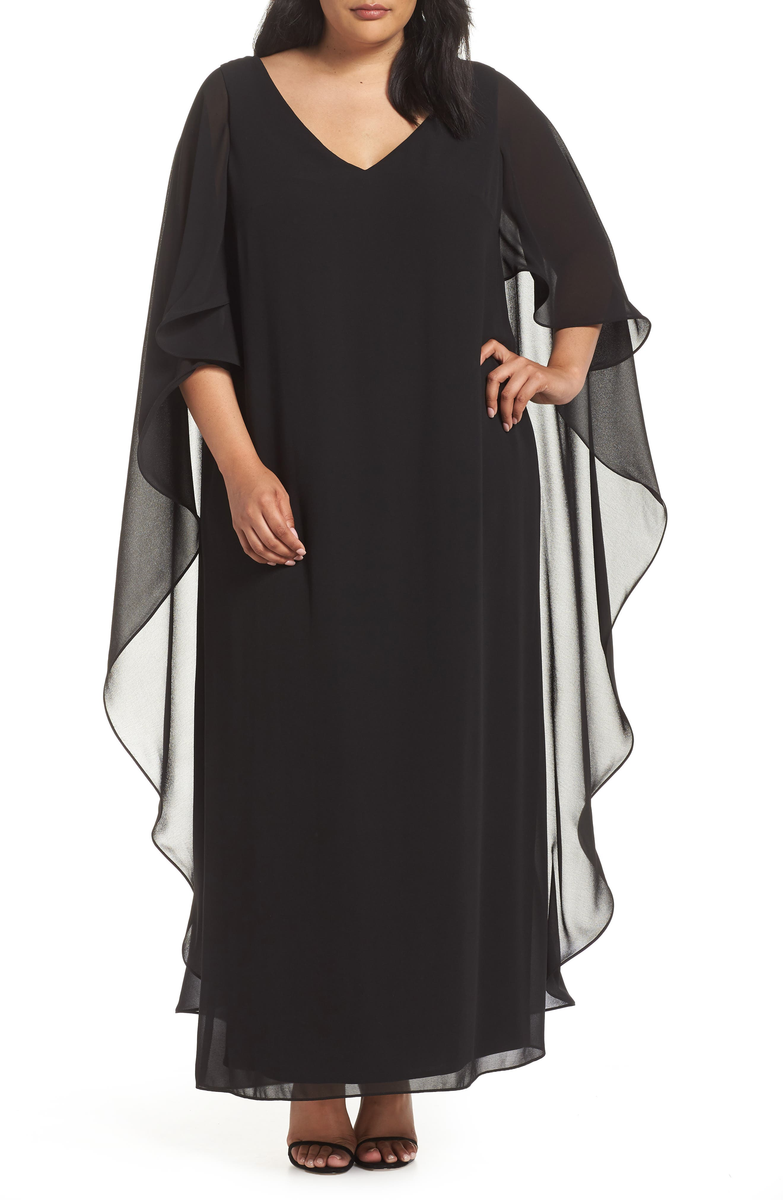 A drapey chiffon overlay romances this V-neck gown boasting night-out elegance. Style Name: Xscape Cape Overlay Chiffon Gown (Plus Size). Style Number: 5735079. Available in stores.