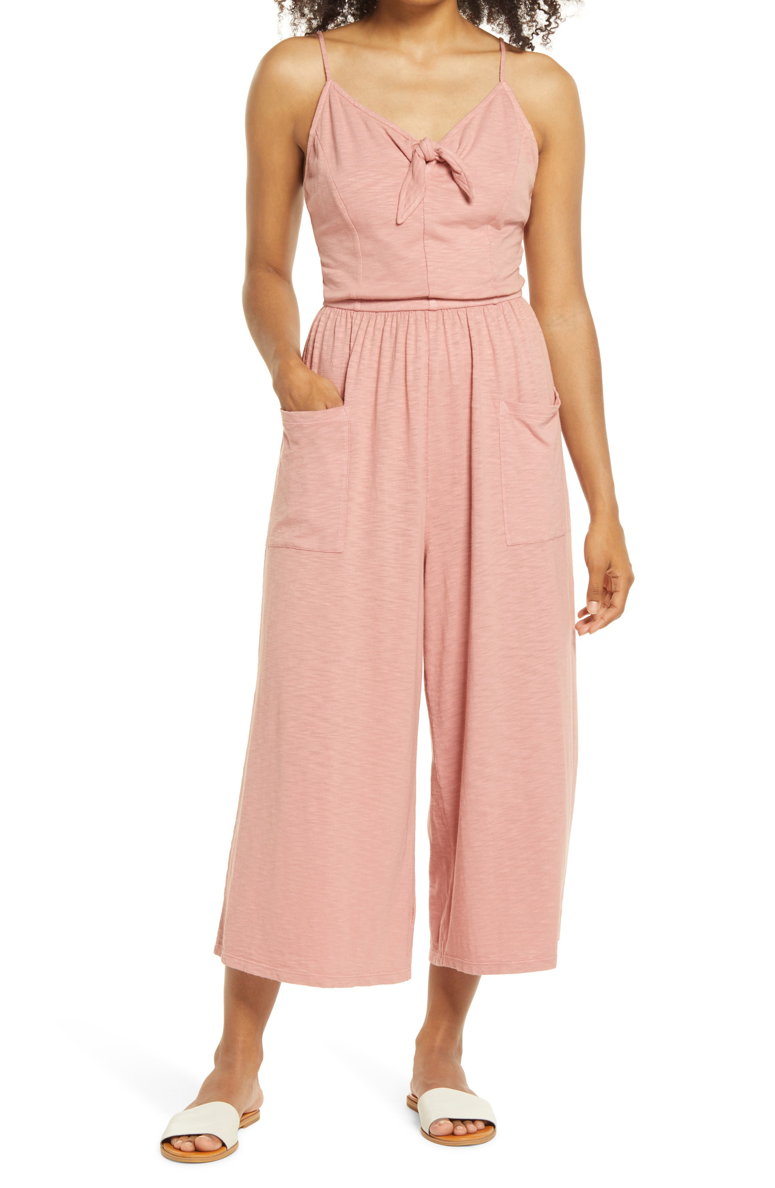 A comfy jumpsuit cut from supersoft slubbed jersey is styled with a cute neck tie, roomy pockets and a gathered waist for a sweet casual look. Style Name: Caslon Tie Neck Jumpsuit. Style Number: 5985718. Available in stores.