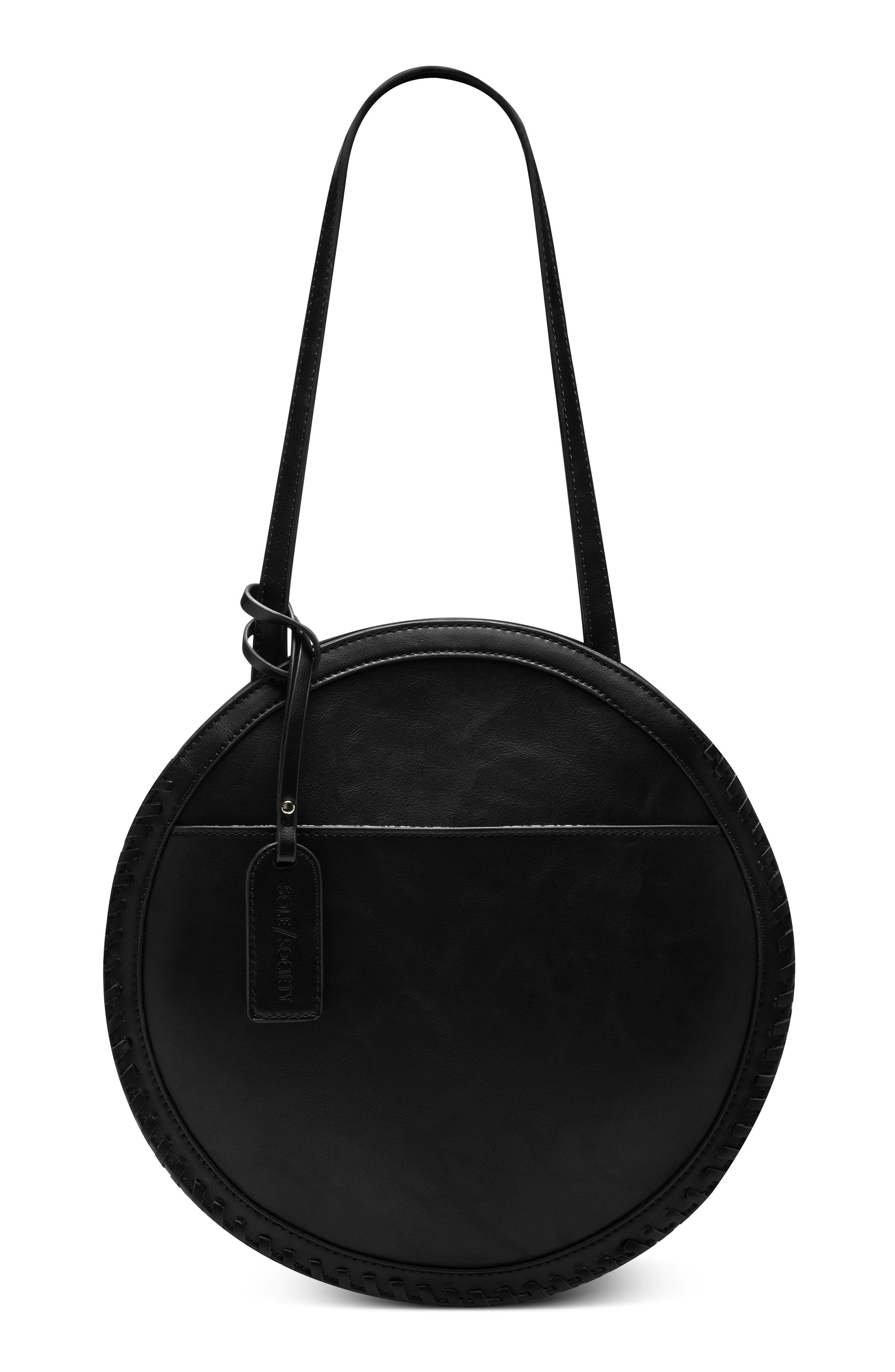 Whipstitches edge a circular faux-leather shoulder bag that instantly transforms your look into a true OOTD. Style Name: Sole Society Cerys Faux Leather Circle Shoulder Bag. Style Number: 6070470. Available in stores.