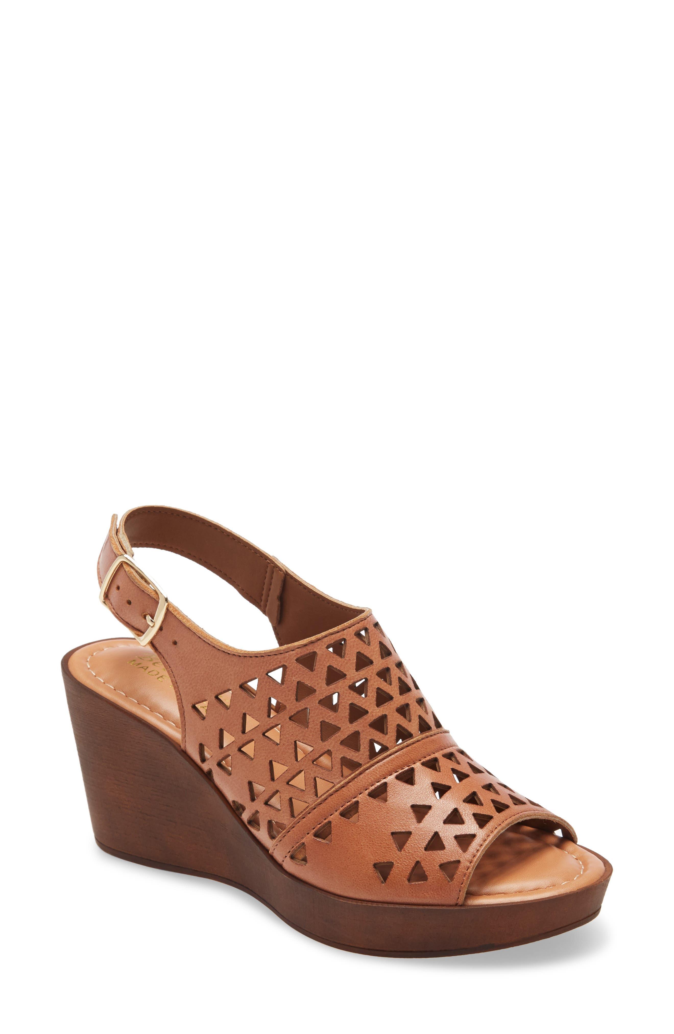 Triangular cutouts perforate the vamp of a sleek slingback sandal set on a chunky woodgrain platform wedge. Style Name: Bella Vita Italy Cutout Slingback Sandal (Women). Style Number: 5984401. Available in stores.