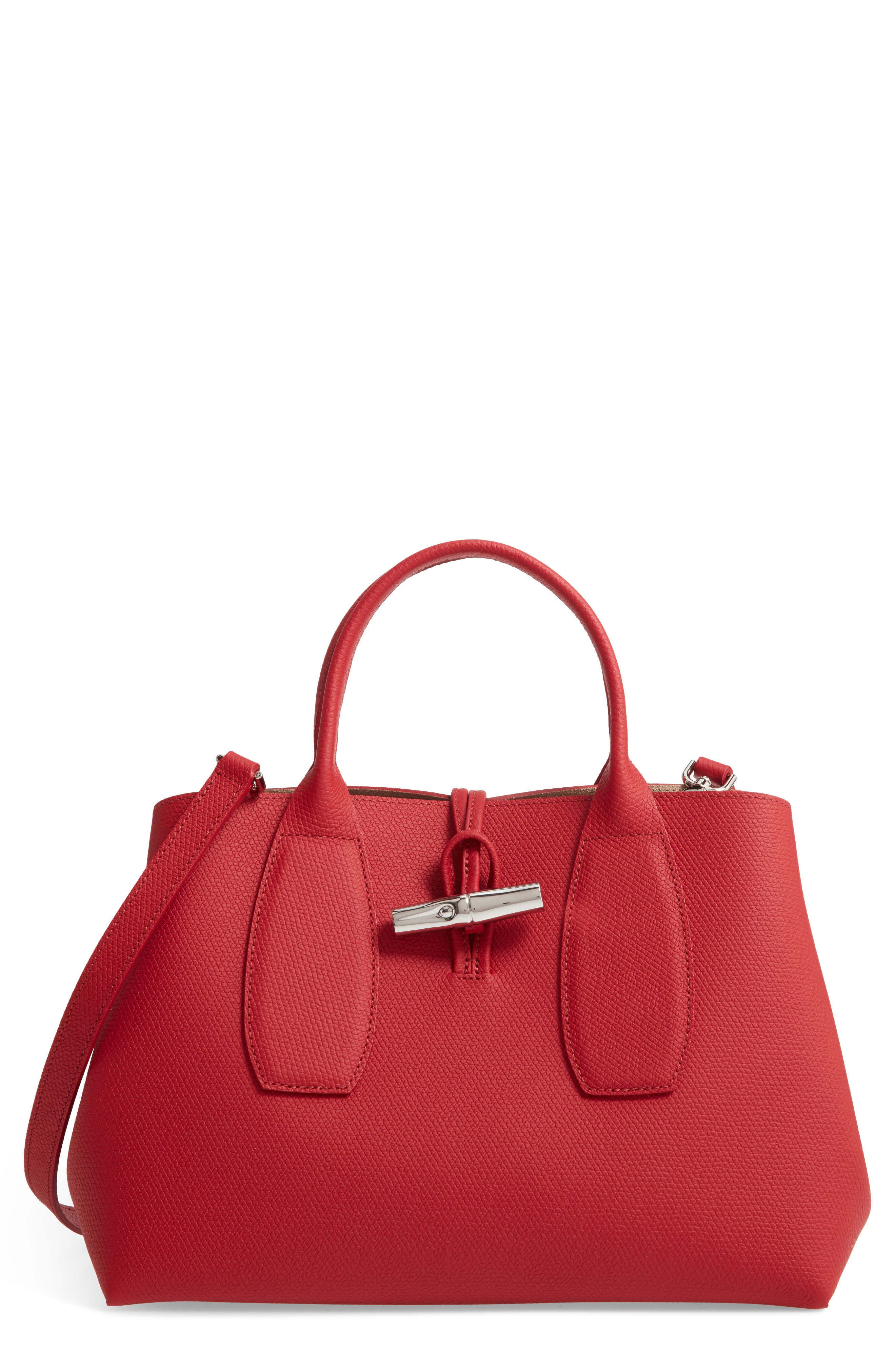 Richly pebbled leather textures a roomy tote fitted with snap gussets so you can size it to accommodate everything you need for an outing. The top handles are the perfect length for carrying by hand or slinging over a shoulder. Style Name: Longchamp Medium Roseau Leather Tote. Style Number: 5947230. Available in stores.