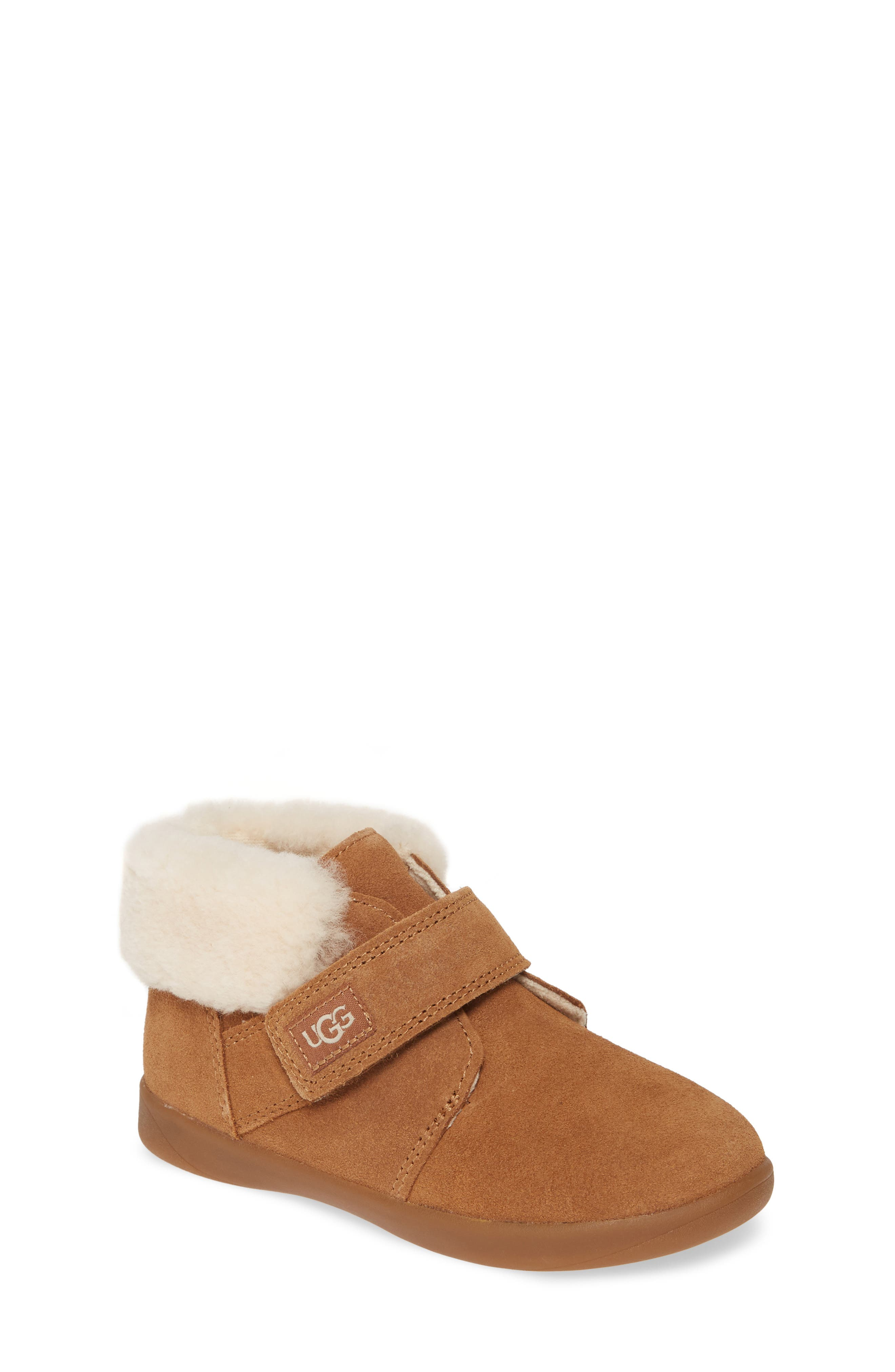 A cuff of plush genuine shearling underscores the cozy appeal of a favorite boot topped by an easy-on strap. The lining is made of UGGpure, a textile made entirely from wool to feel and wear like genuine shearling. Style Name: UGG Nolen Genuine Shearling Boot (Walker & Toddler). Style Number: 5884329. Available in stores.