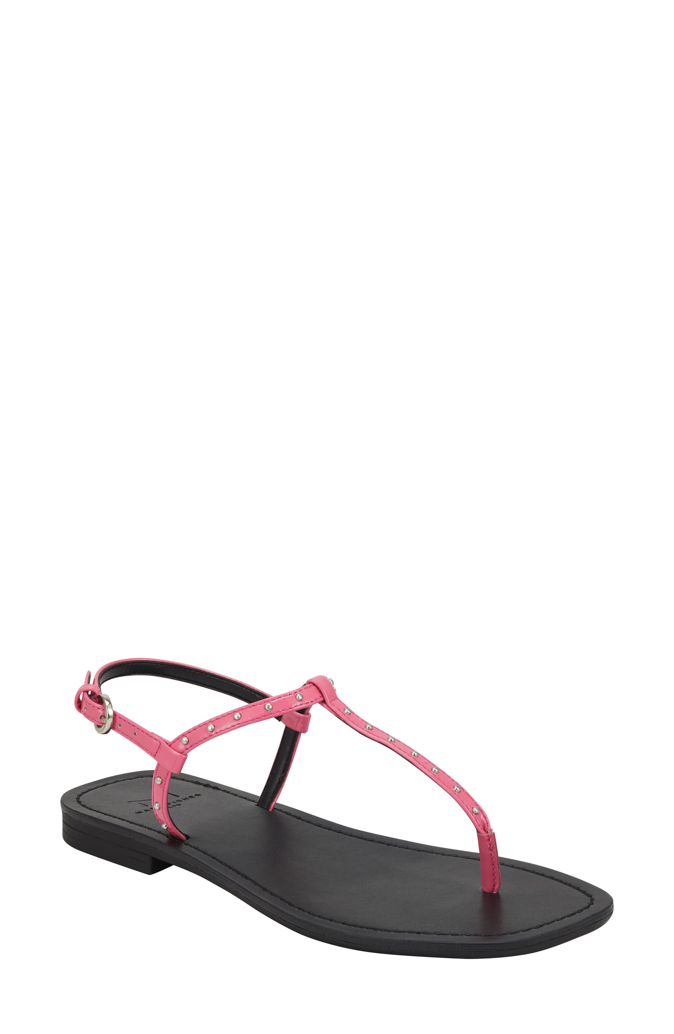 Polished studs highlight the slender straps of a classic thong-strap sandal that\\\'s updated with a trendy angled toe. Style Name: Marc Fisher Ltd Fallona Studded Sandal (Women). Style Number: 6003489. Available in stores.
