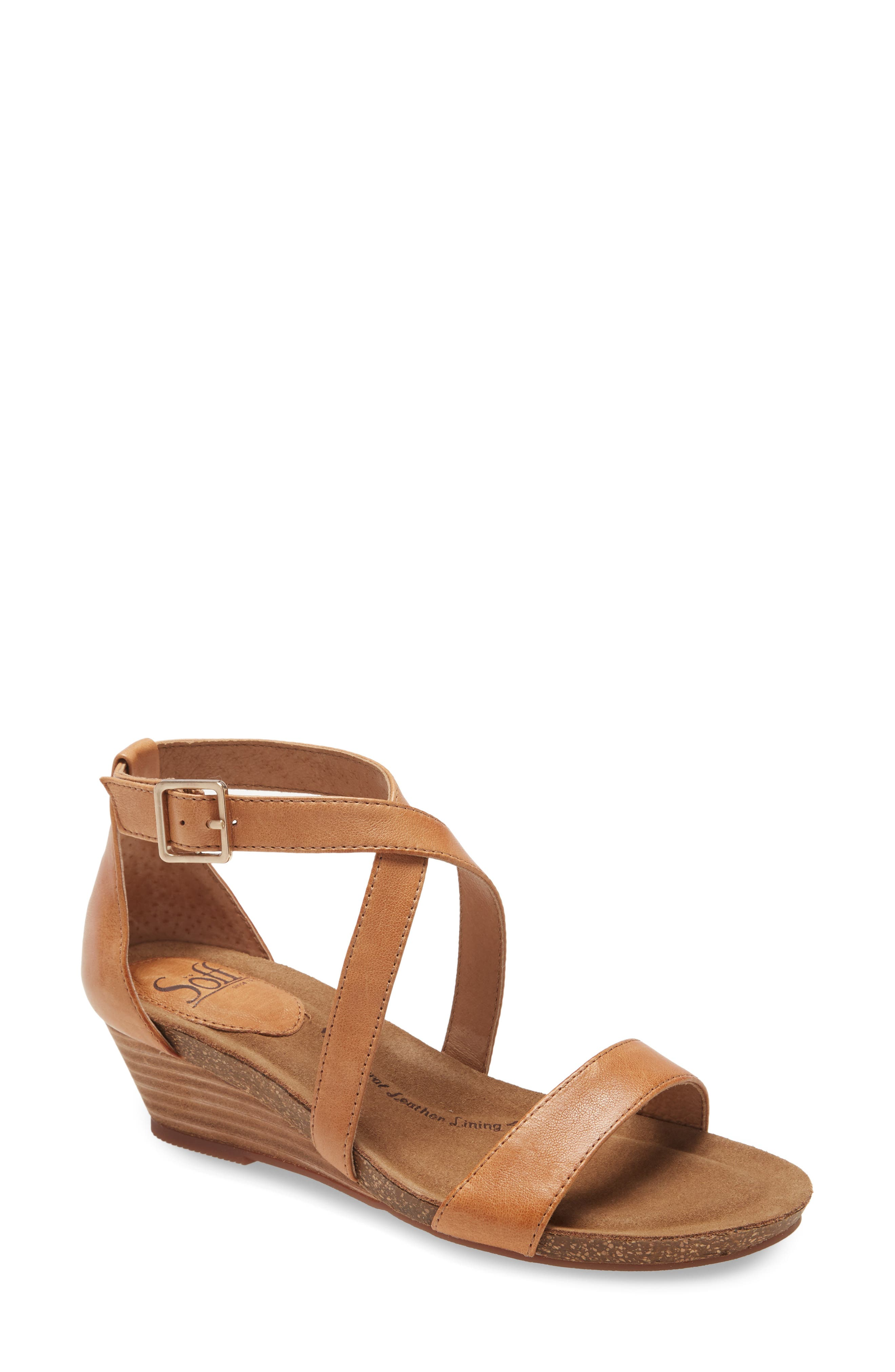 Crossed and buckled straps stylishly secure this wedge sandal that features a plush, sink-in footbed for all-day comfort. Style Name: Sofft Valeryn Wedge Sandal (Women). Style Number: 5993838. Available in stores.