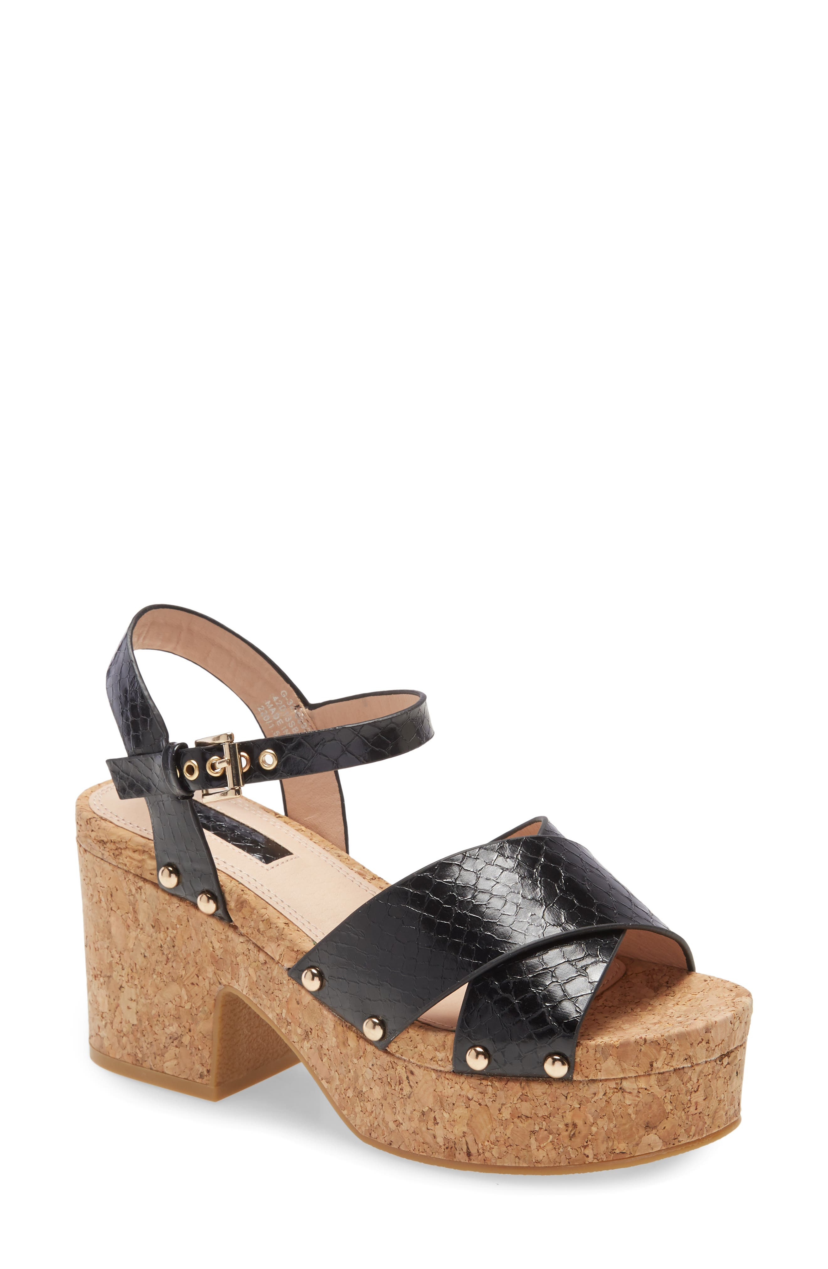 A cork-textured platform ramps up to a chunky block heel under a sandal that kicks up its groovy-retro vibe even further with bands of snakeskin-stamped straps. Style Name: Topshop Platform Sandal (Women). Style Number: 6084322. Available in stores.
