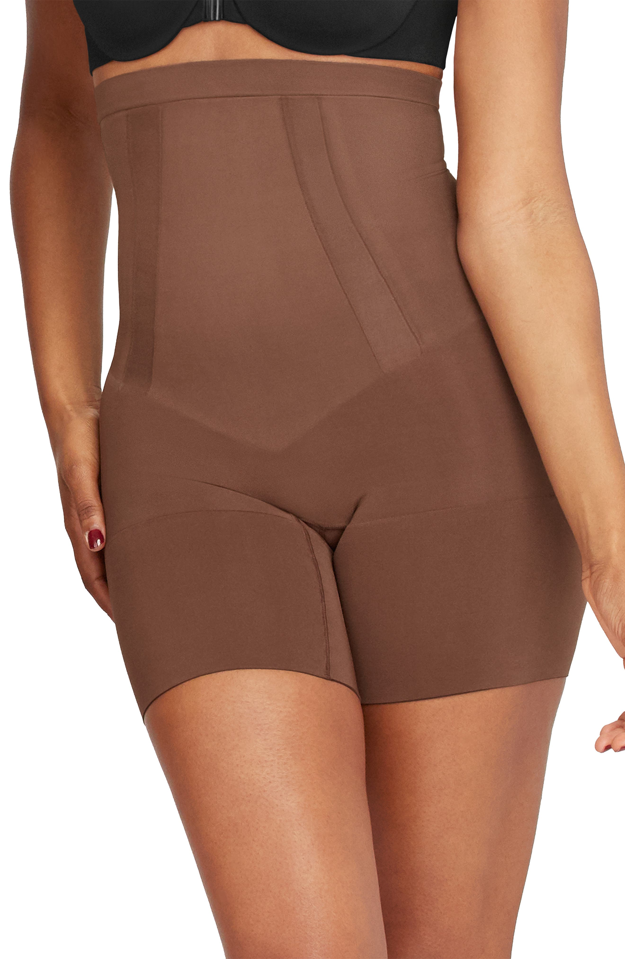 Light yet powerful, this sculpting shaper has fully bonded front panels for a tabletop flat stomach and edge-bonded sides for comfy, squeeze-free slimming. Style Name: Spanx Oncore High Waist Mid Thigh Shaper Shorts. Style Number: 1049897. Available in stores.