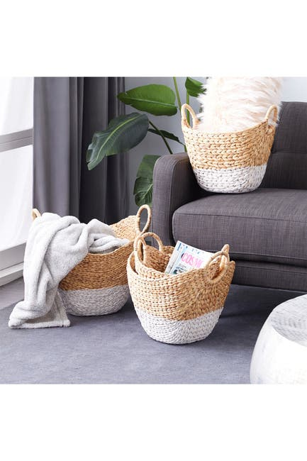 Image of CosmoLiving by Cosmopolitan Oval Natural and White Dip-Dyed Water Hyacinth Wicker Storage Baskets with Round Handles - Set of 4