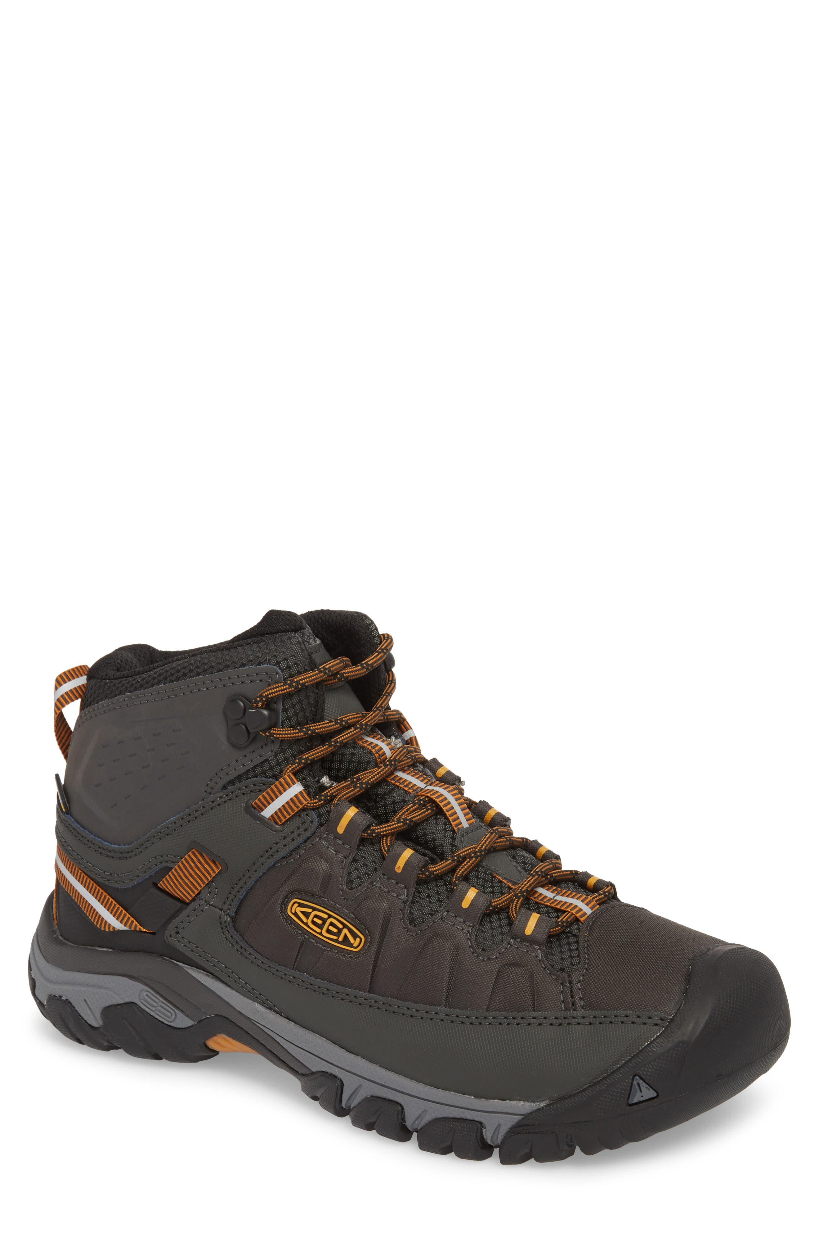 This sturdy, waterproof hiking boot crafted from polyurethane-coated leather and durable performance mesh stands up easily to all your off-road exploring. A metatomical footbed offers superior cushioning and arch support, while the high-traction rubber sole provides multi-directional grip and stability in any terrain. Style Name: Keen Targhee Exp Mid Waterproof Hiking Boot (Men). Style Number: 5624844. Available in stores.