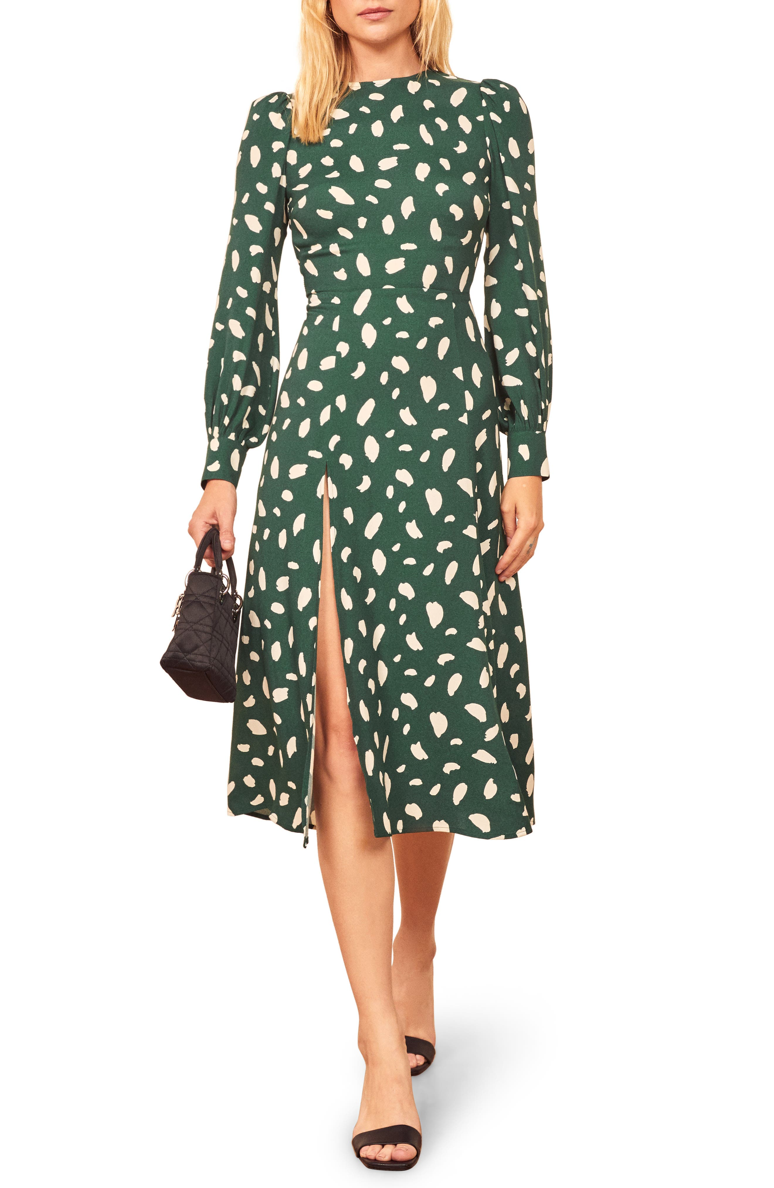 Playful prints brighten this romantic frock, styled with an airy keyhole back and a stem-showing side slit. Style Name: Reformation Creed Print Long Sleeve Midi Dress. Style Number: 5922996. Available in stores.