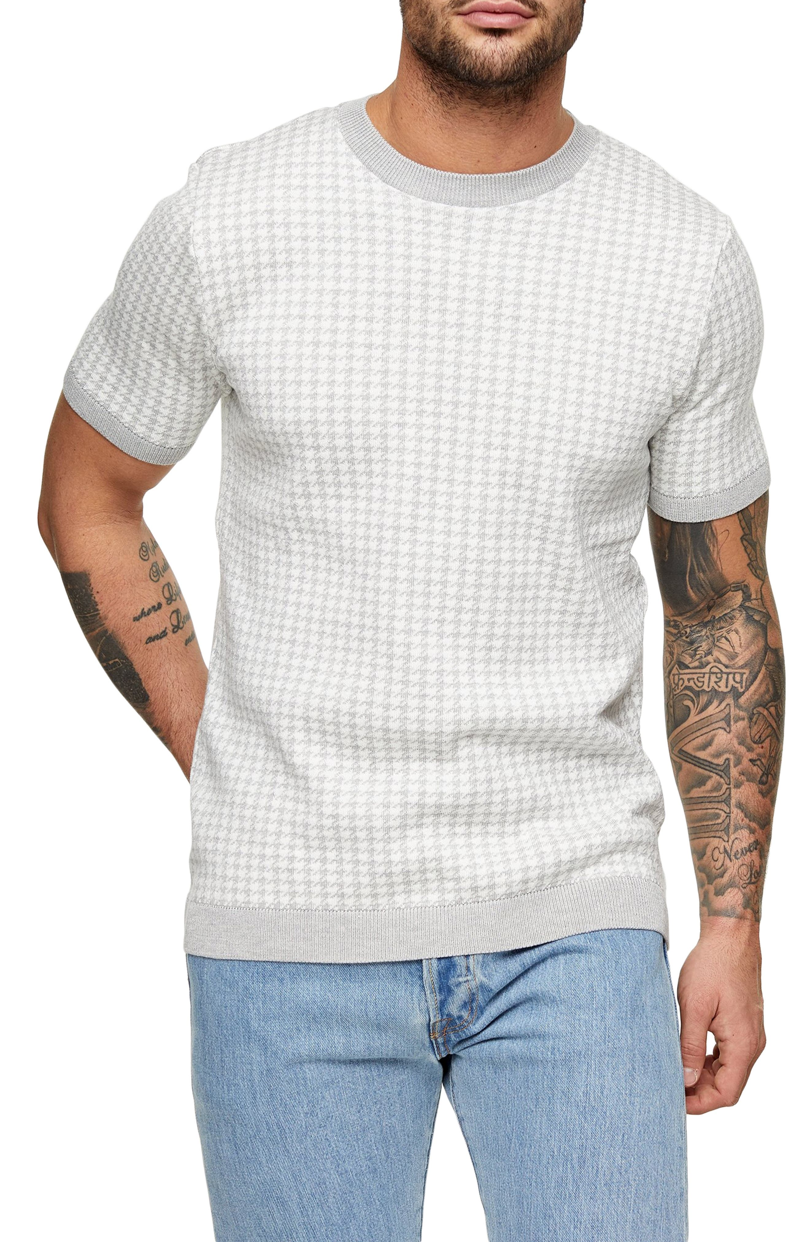 A houndstooth pattern makes this short-sleeve sweater a suave, stylish standout. Style Name: Topman Houndstooth Short Sleeve Sweater. Style Number: 6051474. Available in stores.