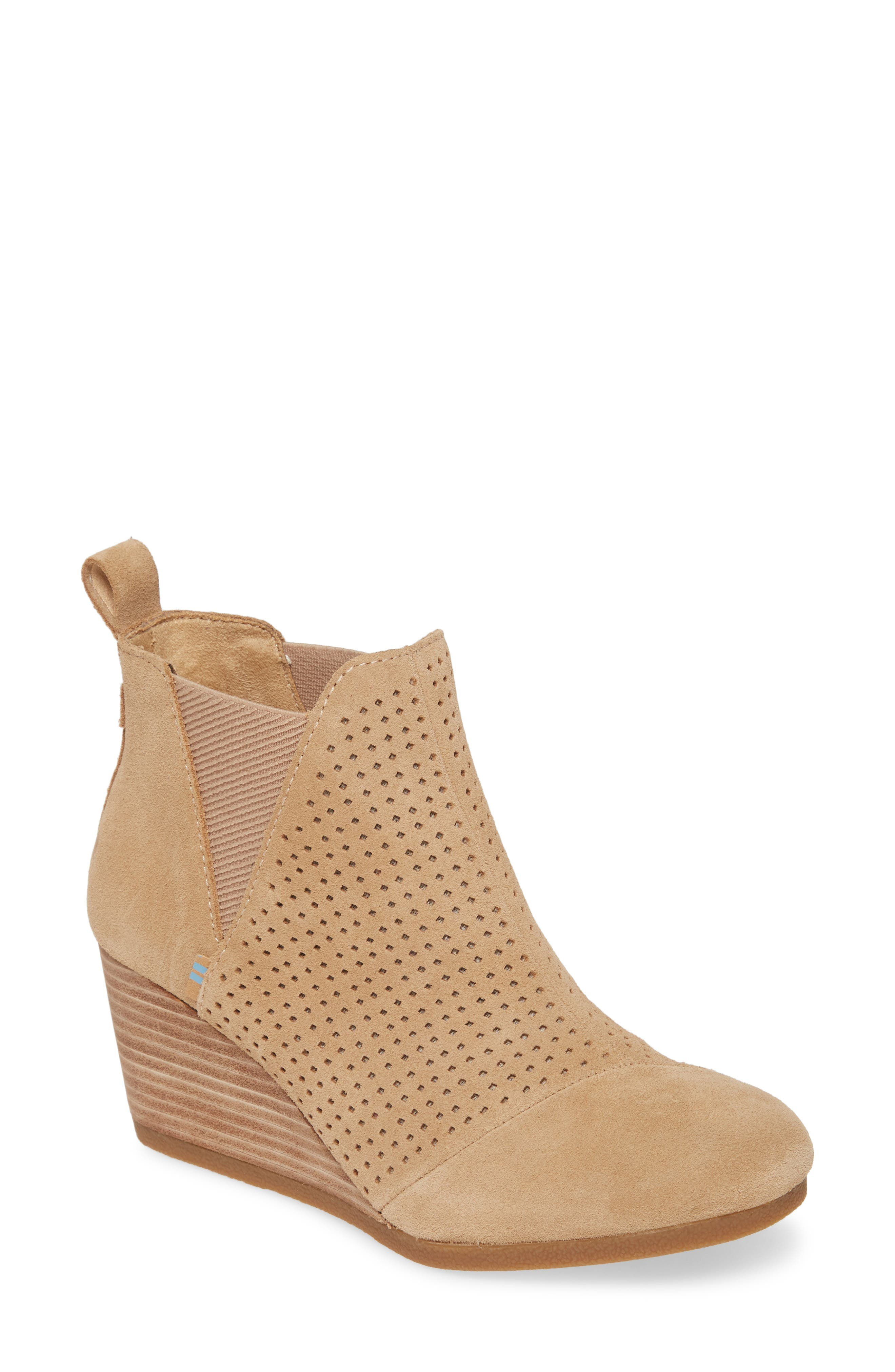 Allover perforations add modern edge to this Chelsea-inspired wedge bootie. Style Name: Toms Kelsey Bootie (Women). Style Number: 5899292 1. Available in stores.