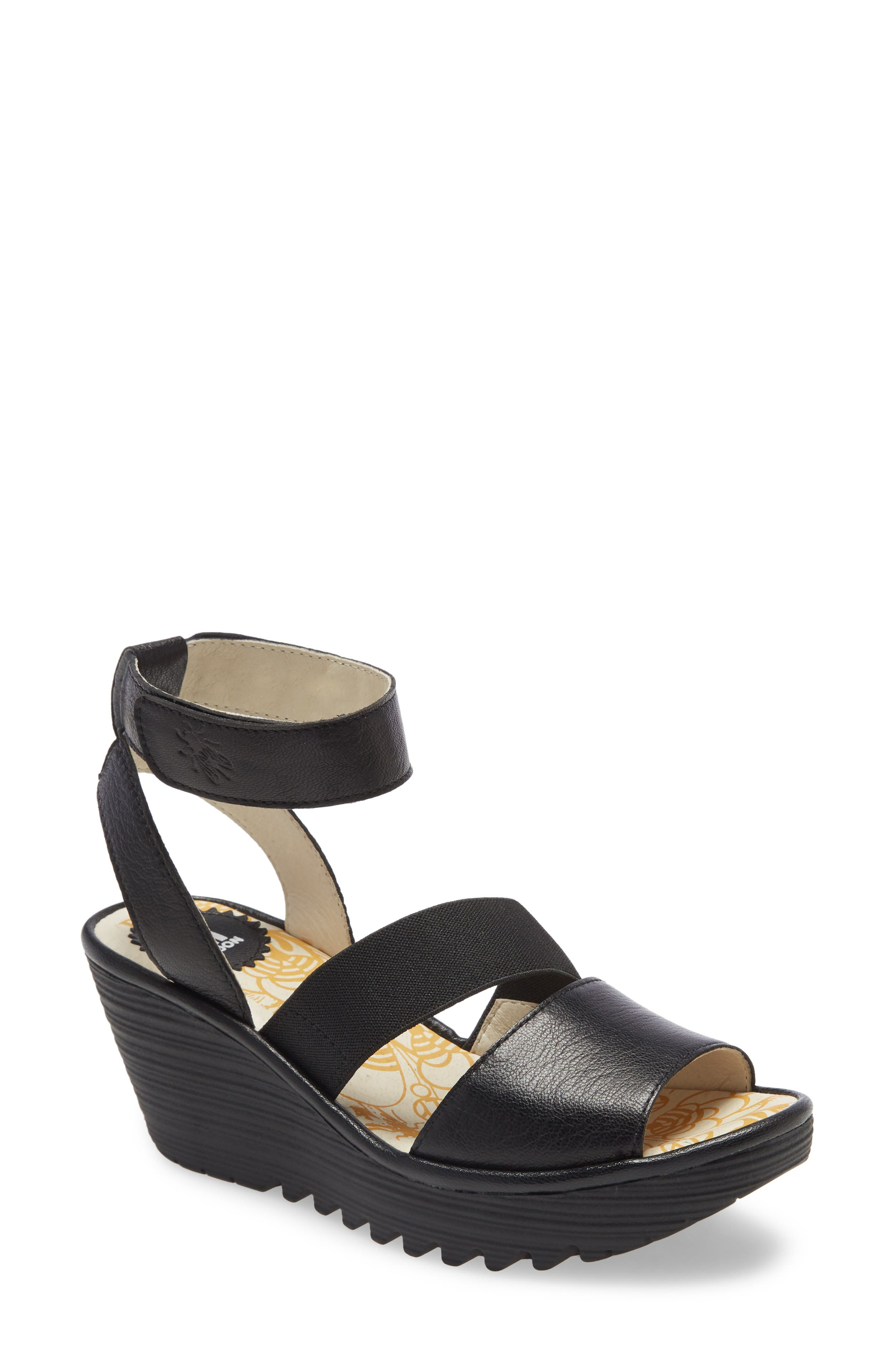 Razored treads and a textured wedge and platform add to the sporty look of an ankle-strap sandal made with a cushioned footbed. Style Name: Fly London Yode Wedge Sandal (Women). Style Number: 6002357. Available in stores.