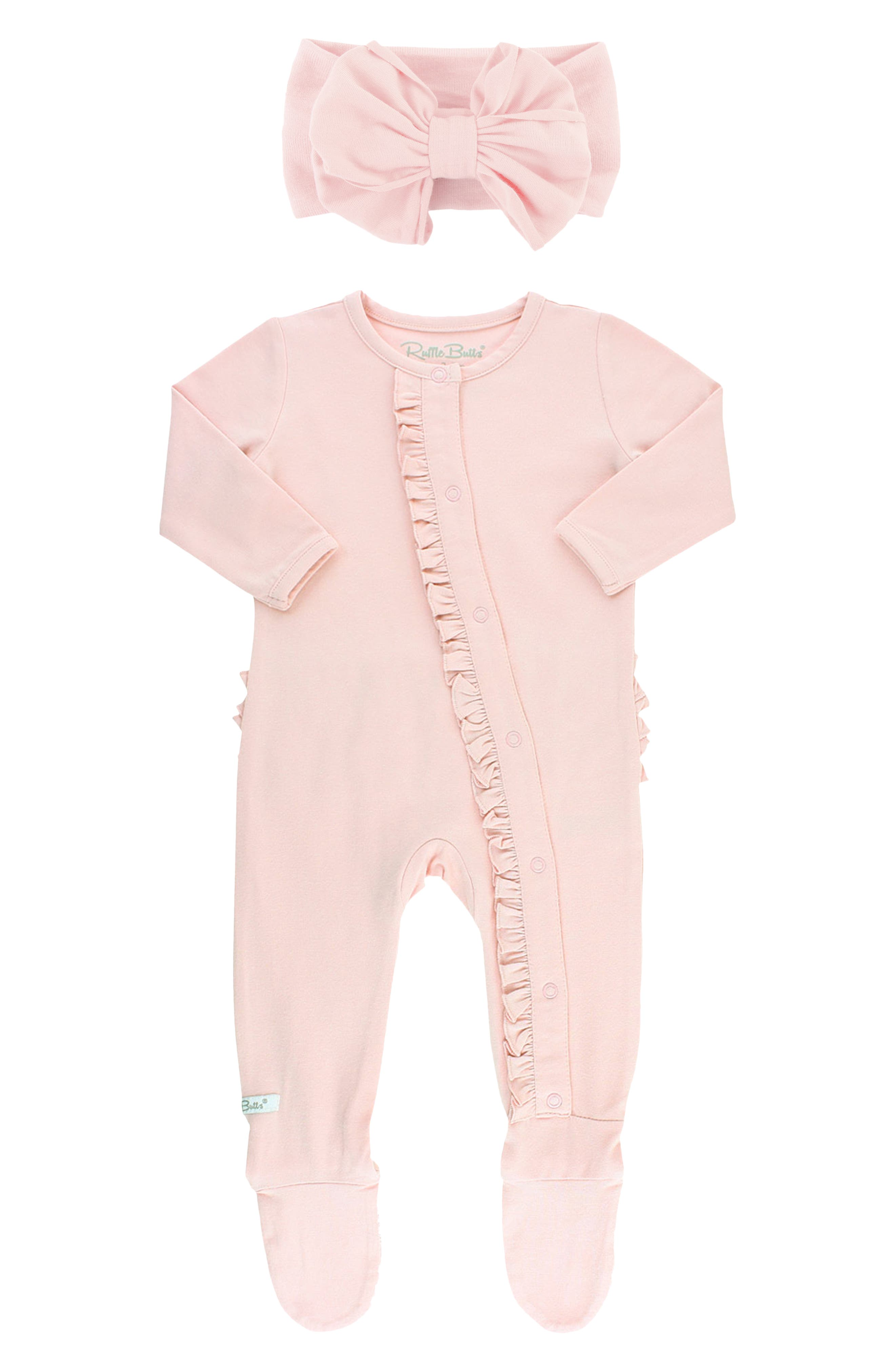 Just because the day is ending doesn\\\'t mean baby\\\'s cute style has to-enter these pretty-in-pink jammies with signature ruffles across the derriere. The luxuriously soft and lightweight fabric is perfect for taking your little one from naptime to playtime in total comfort. This footed style is paired with a bowed head wrap to keep the pajama party going all day long. Style Name: Rufflebutts Ballet Pink Ruffle Fitted One-Piece Pajamas & Head Wrap